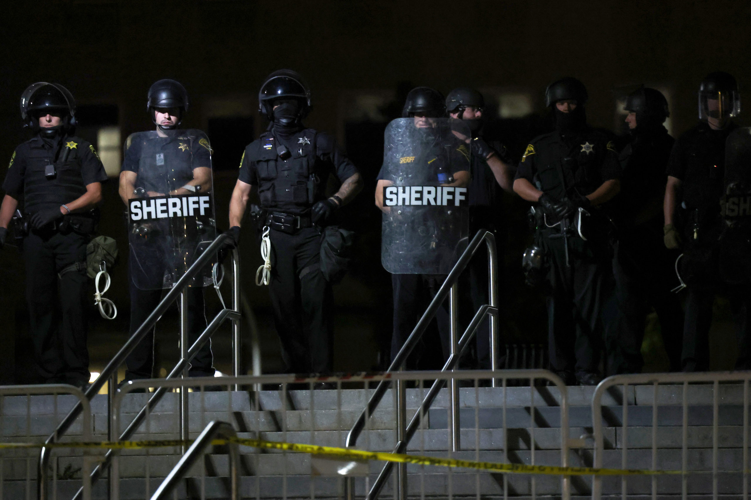 ROCHESTER, NEW YORK - SEPTEMBER 06: Police officers stand in line as demonstrators take up space in front of the Public Safety building after marching for Daniel Prude on September 06, 2020 in Rochester, New York. Prude died after being arrested on March 23 by Rochester police officers who had placed a