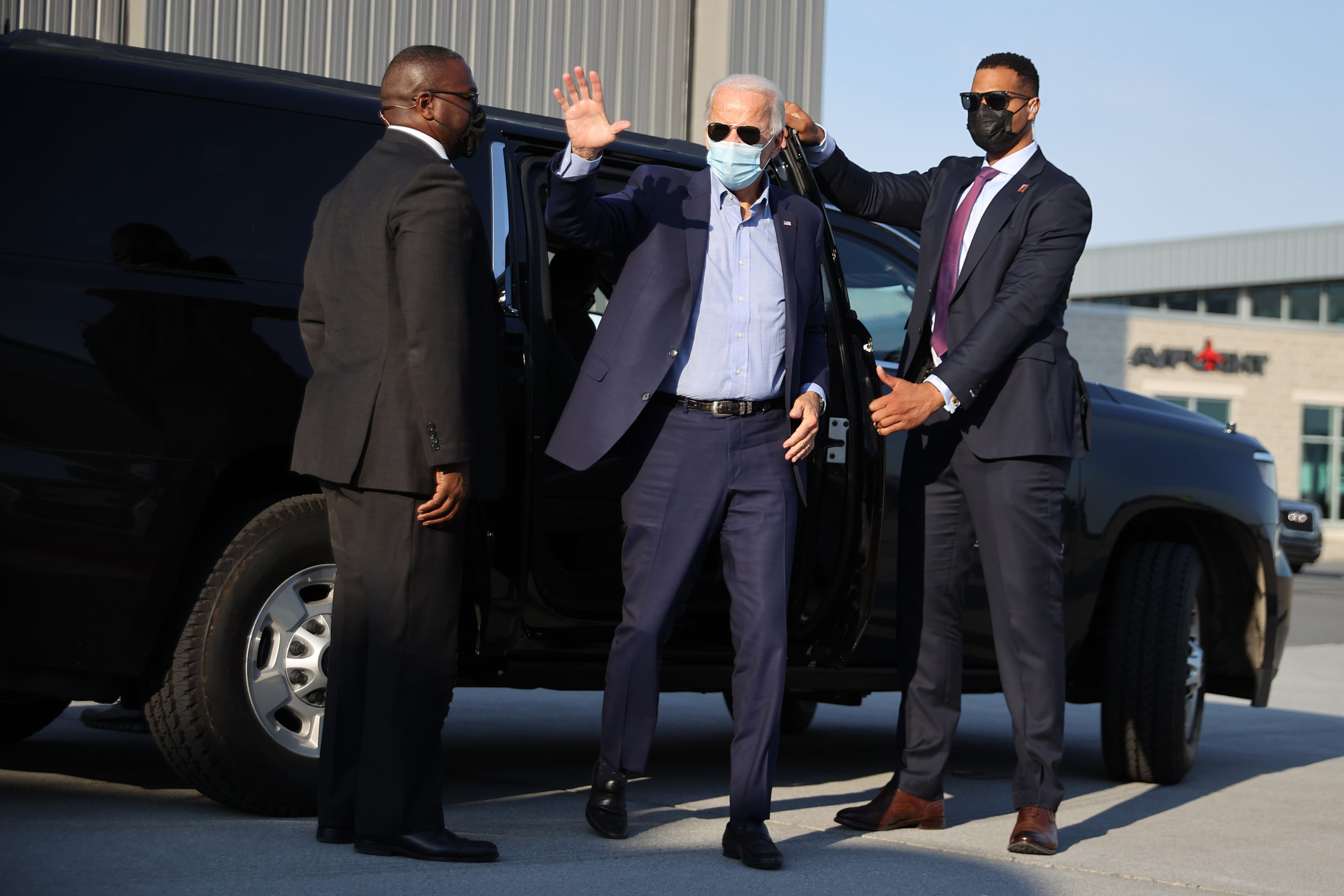 MIDDLETOWN, PENNSYLVANIA - SEPTEMBER 07: Wearing a face mask to reduce the risk posed by the coronavirus, Democratic presidential candidate and former Vice President Joe Biden prepares to board an airplane after meeting with local labor leaders at the state's AFL-CIO headquarters on Labor Day, September 07, 2020 in Middletown, Pennsylvania. Due to the ongoing coronavirus pandemic, Biden's campaign has organized more virtual events, engaging with supporters using video teleconferencing. (Photo by Chip Somodevilla/Getty Images)