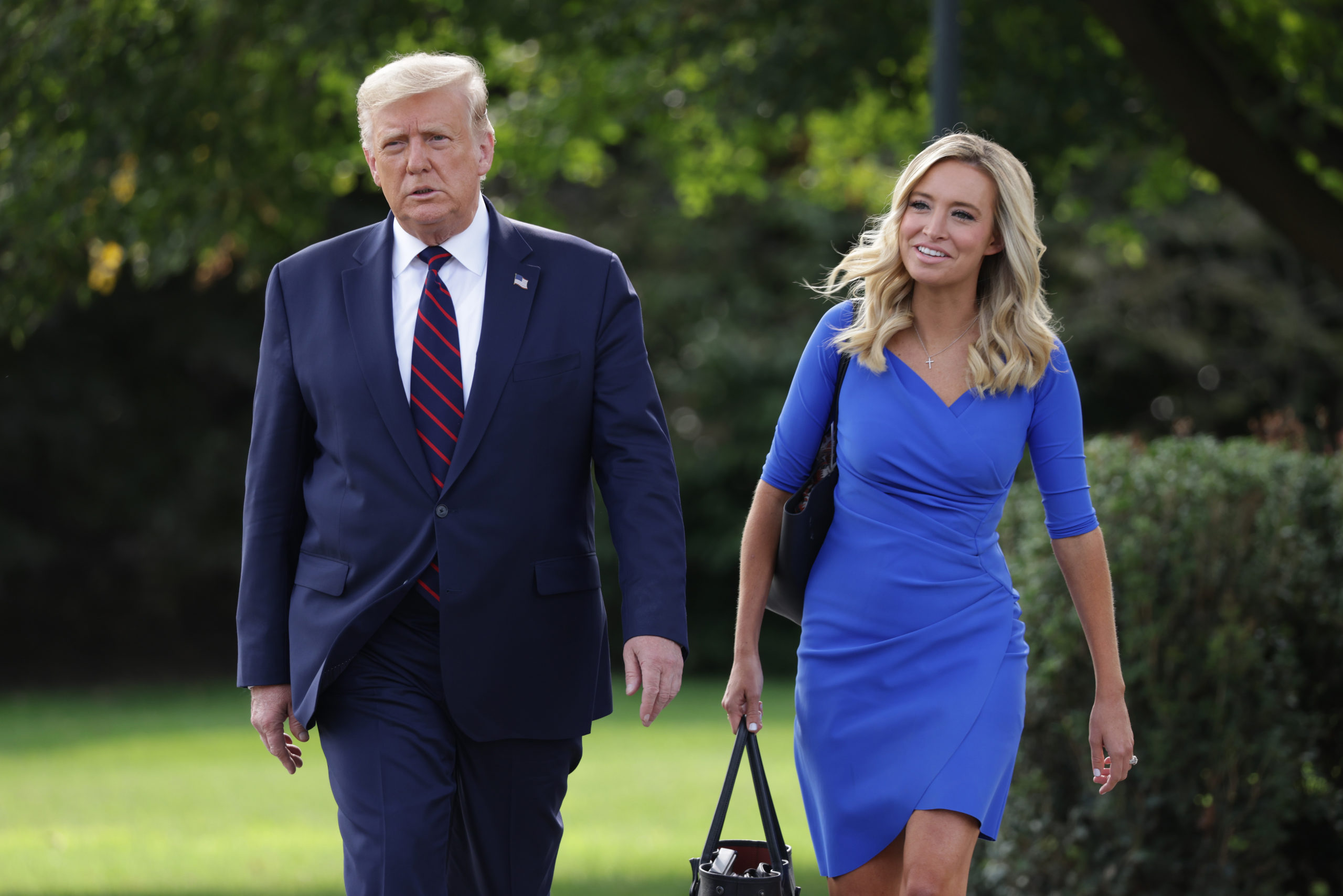 WASHINGTON, DC - SEPTEMBER 15: U.S. President Donald Trump and White House Press Secretary Kayleigh McEnany walk toward members of the press prior to Trump's departure from the White House on September 15, 2020 in Washington, DC. President Trump was traveling to Philadelphia to participate in an ABC News town hall event. (Photo by Alex Wong/Getty Images)