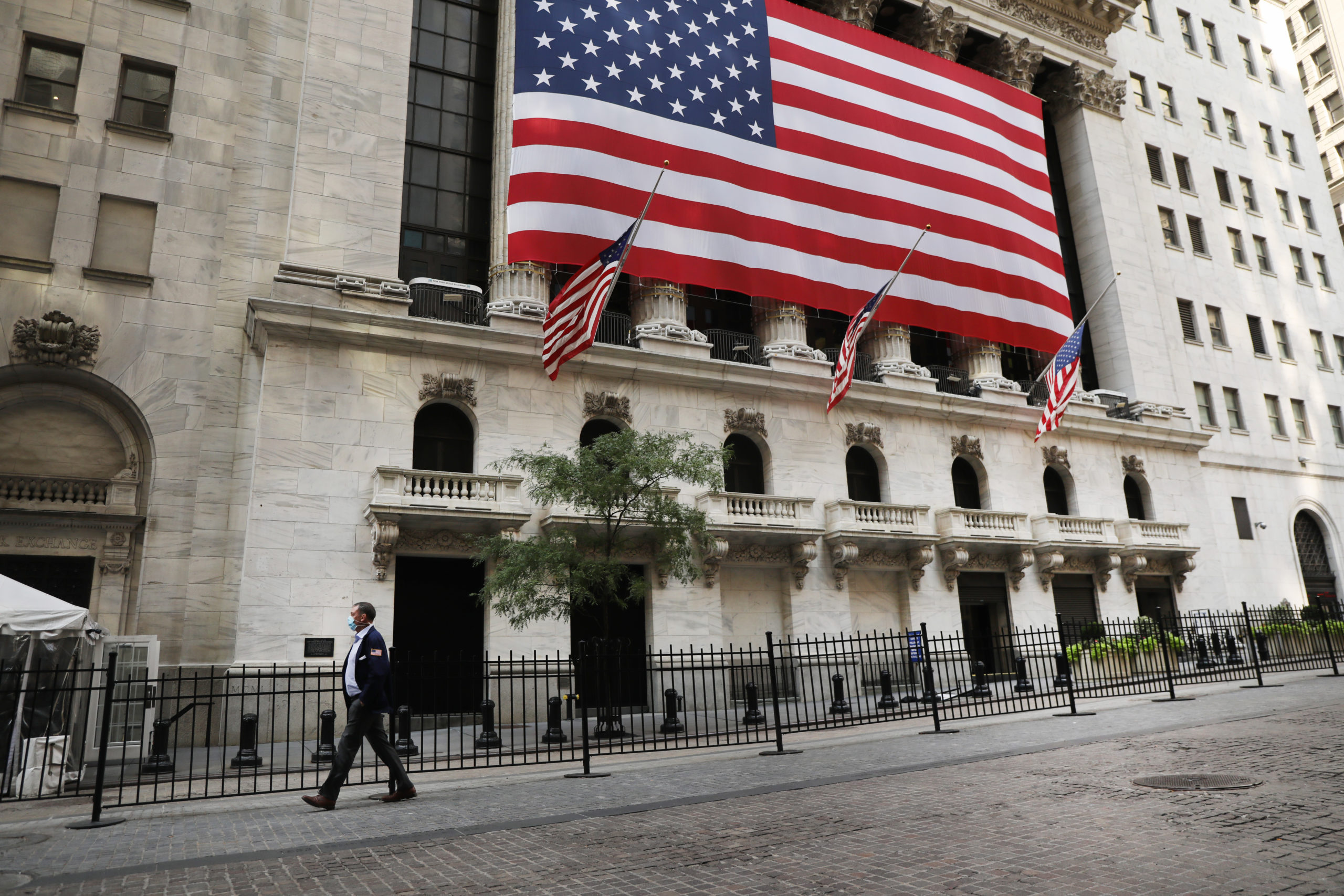 A person walks in front of the New York Stock Exchange in lower Manhattan on September 21, 2020 in New York City. (Spencer Platt/Getty Images)