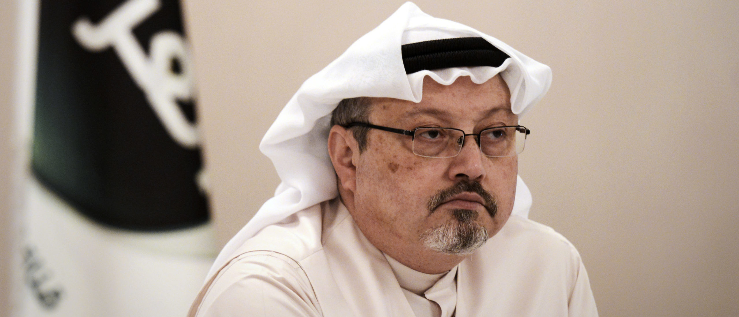 Jamal Khashoggi looks on during a press conference in the Bahraini capital Manama, on December 15, 2014. (Mohammed Al-Shaikh/AFP via Getty Images)