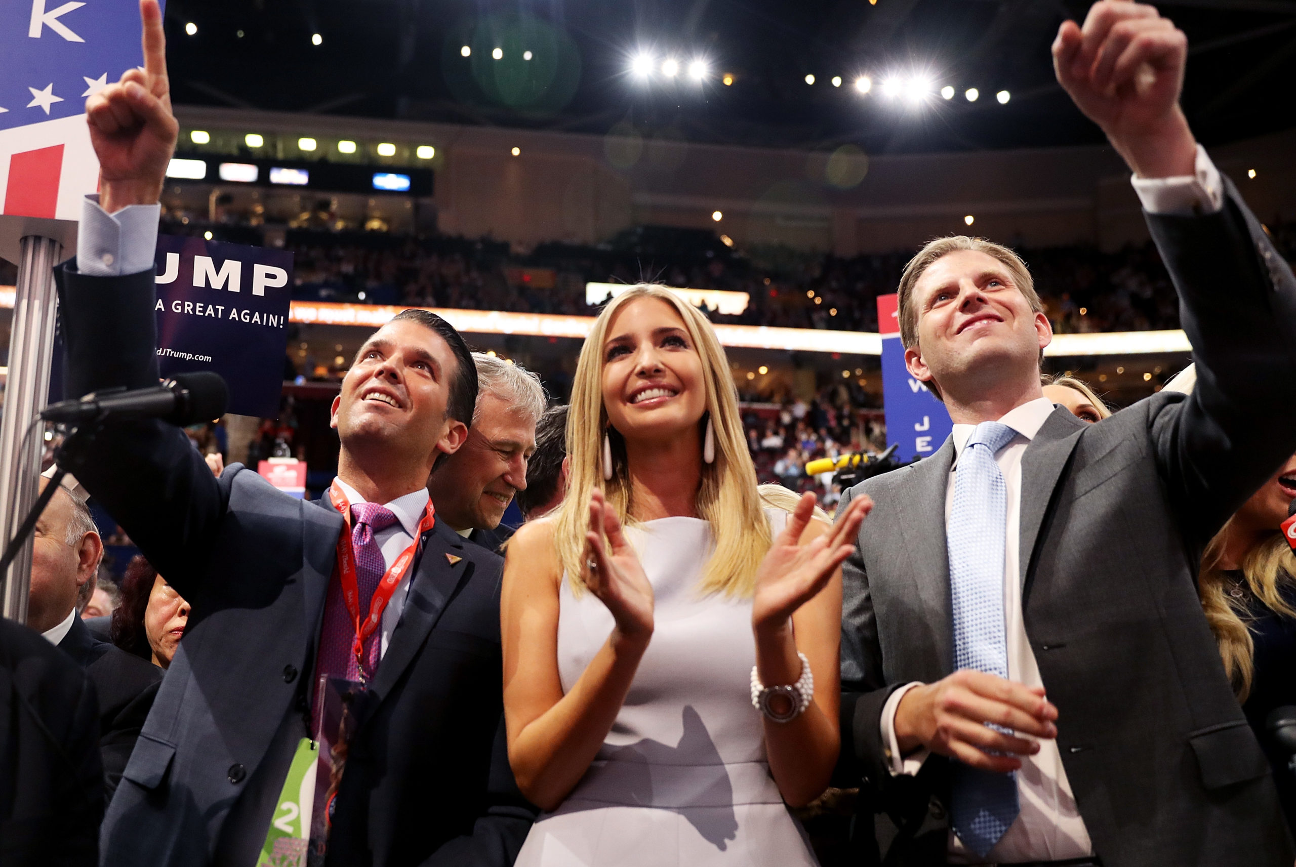 Donald Trump Jr. (L), along with Ivanka Trump (C) and Eric Trump (R), take part in the roll call in support of Republican presidential candidate Donald Trump on the second day of the Republican National Convention on July 19, 2016 at the Quicken Loans Arena in Cleveland, Ohio. (Joe Raedle/Getty Images)