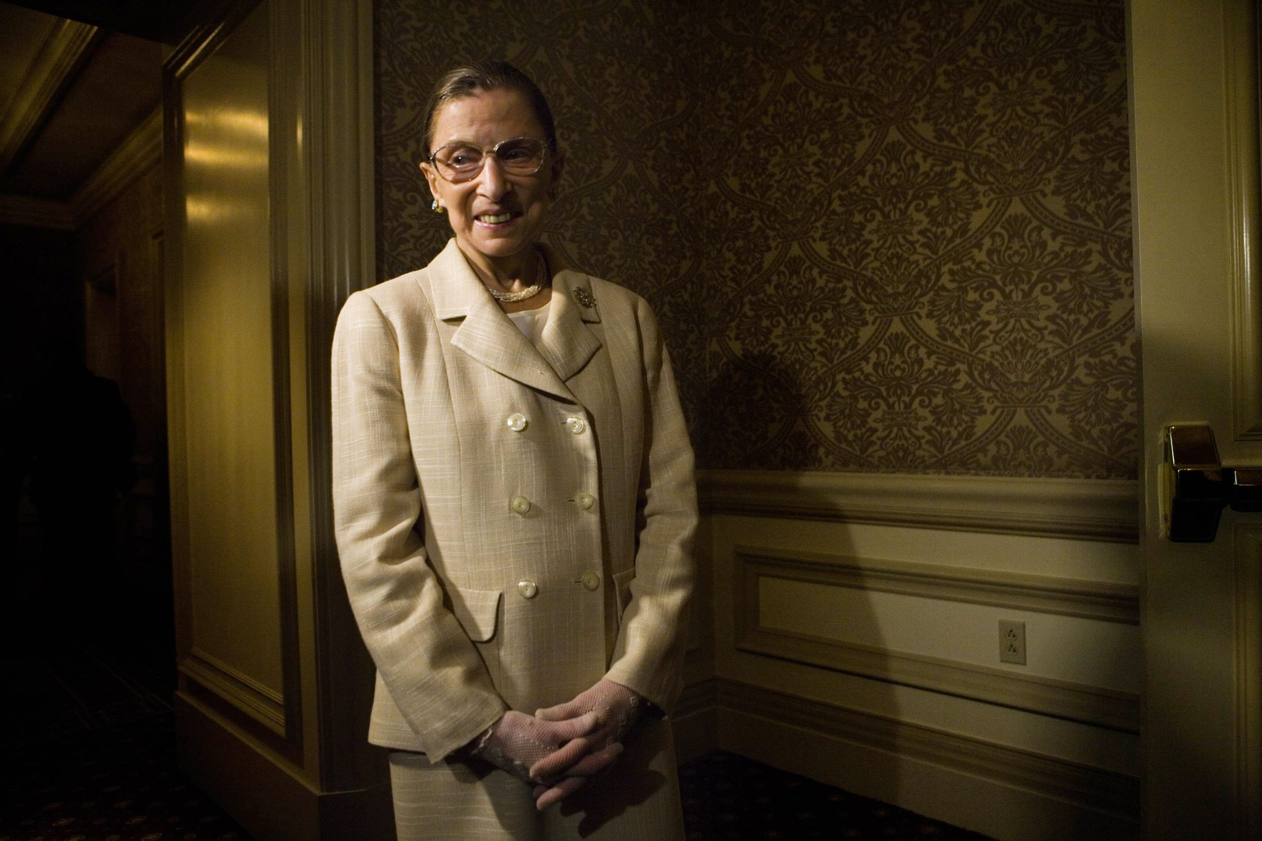 WASHINGTON - JUNE 8: U.S. Supreme Court Justice Ruth Bader Ginsburg waits to enter a dinner to honor Michelle Bachelet, Chile's first female president, May 8, 2006 in Washington, DC. Over 350 women leaders including Sen. Susan Collins (R-MI), Sen. Hillary Rodham Clinton (D-NY), Rep. Janice Schakowsky (D-Il), Rep. Katherine Harris (R-FL), US Treasurer Anna Escobedo Cabral, Actress Geena Davis and Editor-at-Large of Fortune Magazine Pattie Sellers are expected to attend. (Photo by Brendan Smialowski/Getty Images)