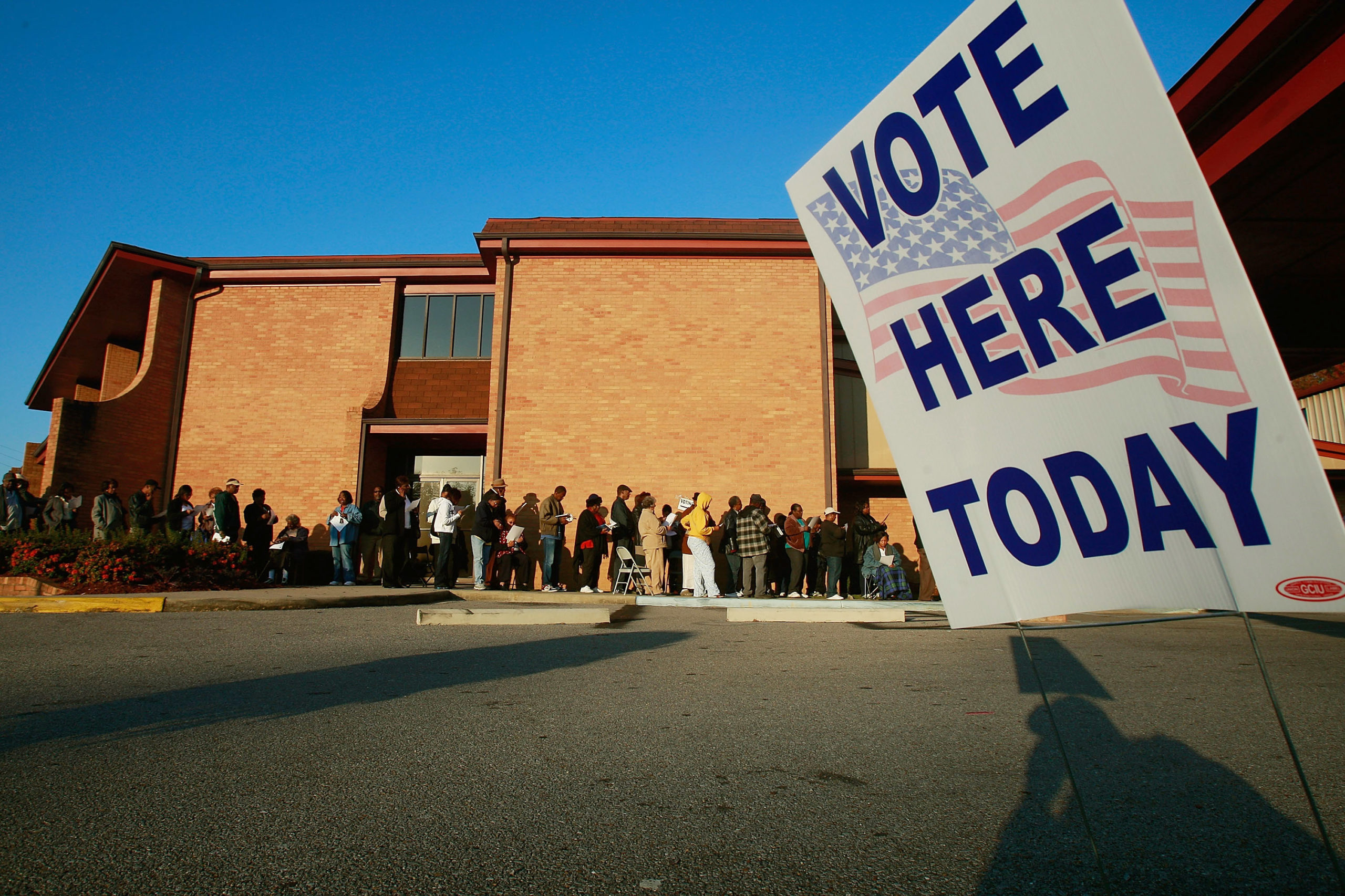 African-Americans line up to vote outside Bethel Missionary Baptist Church in the presidential election November 4, 2008 in Birmingham, Alabama. Birmingham, along with Selma and Montgomery, were touchstones in the civil rights movement where Dr. Martin Luther King Jr. led massive protests which eventually led to the Voting Rights Act of 1965 ending voter disfranchisement against African-Americans. Americans are voting in the first presidential election featuring an African-American candidate, Democratic contender Sen. Barack Obama, who is running against Republican Sen. John McCain. (Photo by Mario Tama/Getty Images)