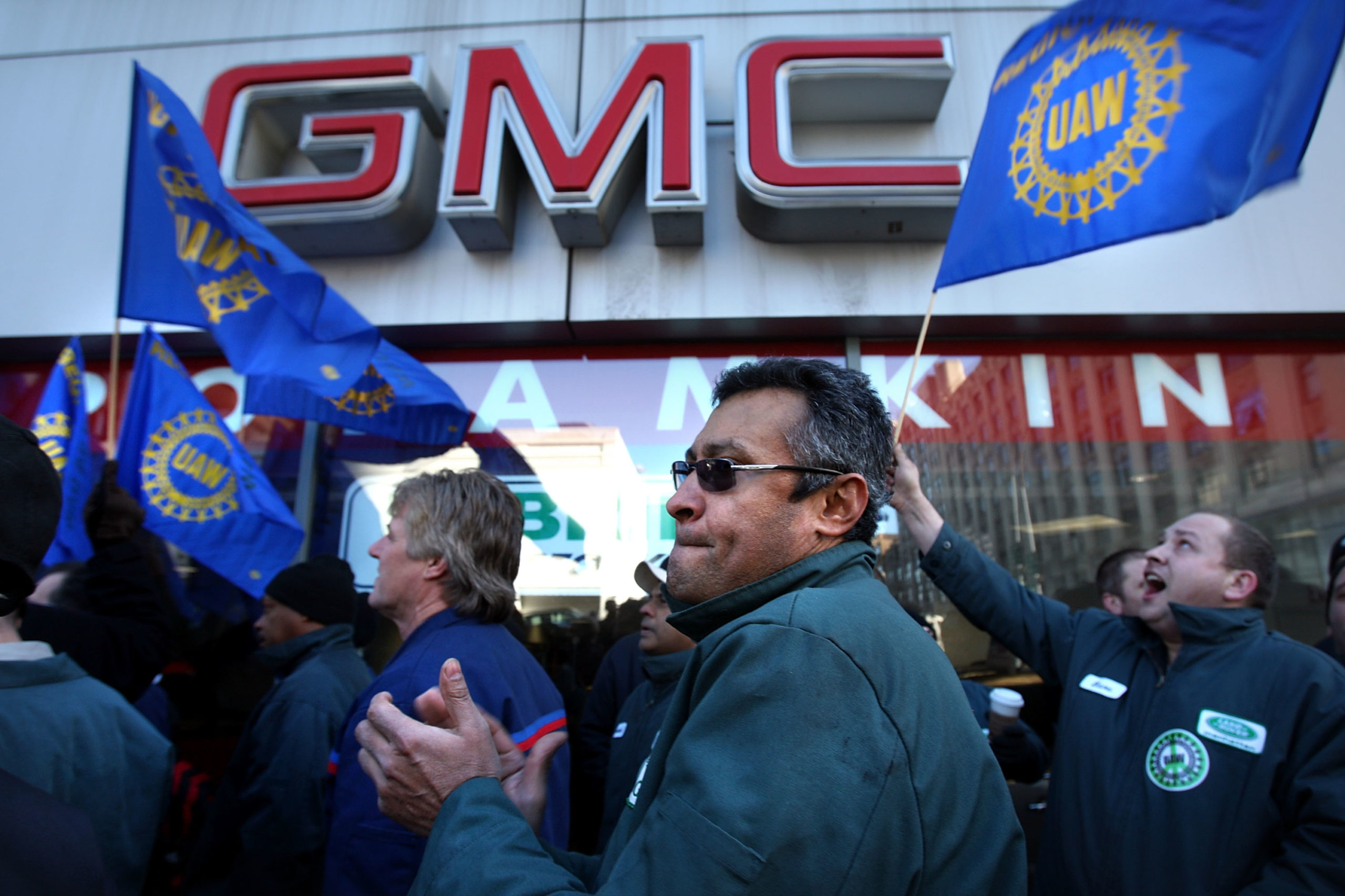 Dozens of area auto dealership employees, members of the United Auto Workers (UAW) and mechanics from both foreign and domestic car makers, rallied in support of the government bailout of the domestic auto industry December 8, 2008 in New York City. (Spencer Platt/Getty Images)