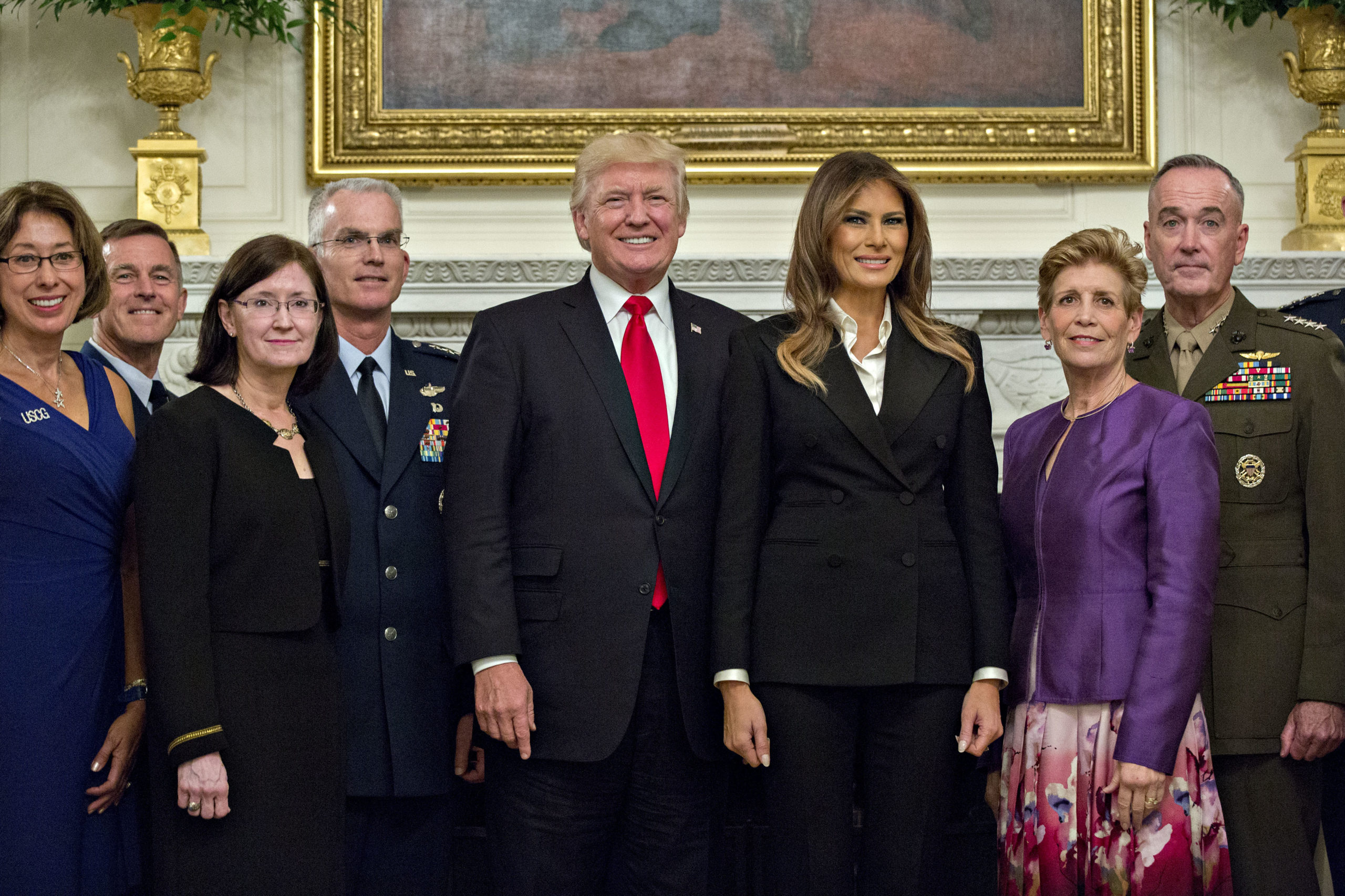 WASHINGTON, DC - OCTOBER 5: U.S. President Donald Trump and first lady Melania Trump pose for pictures with senior military leaders and spouses, including including Gen. Joseph Dunford (R), chairman of the joint chiefs of staff, and General Paul Selva (4th L), vice chairman of the joint chiefs of staff, after a briefing in the State Dining Room of the White House October 5, 2017 in Washington, D.C. The Trumps are hosting the group for a dinner in the Blue Room. (Photo by Andrew Harrer-Pool/Getty Images)