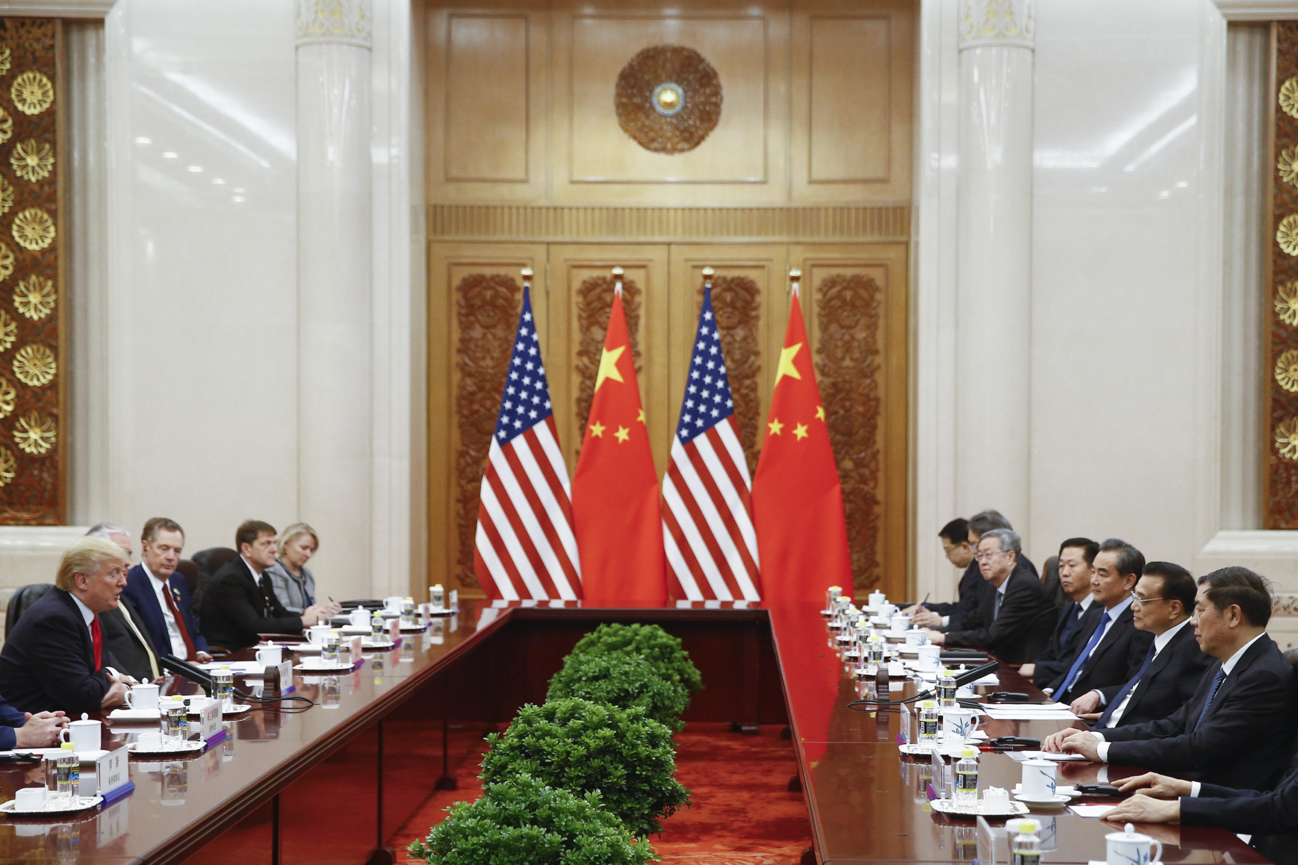 Chinese Premier Li Keqiang (2nd R) meets with US President Donald Trump (L) at the Great Hall of the People in Beijing on November 9, 2017. Donald Trump and Xi Jinping put their professed friendship to the test on November 9 as the least popular US president in decades and the newly empowered Chinese leader met for tough talks on trade and North Korea. / AFP PHOTO / POOL / THOMAS PETER (Photo credit should read THOMAS PETER/AFP via Getty Images)