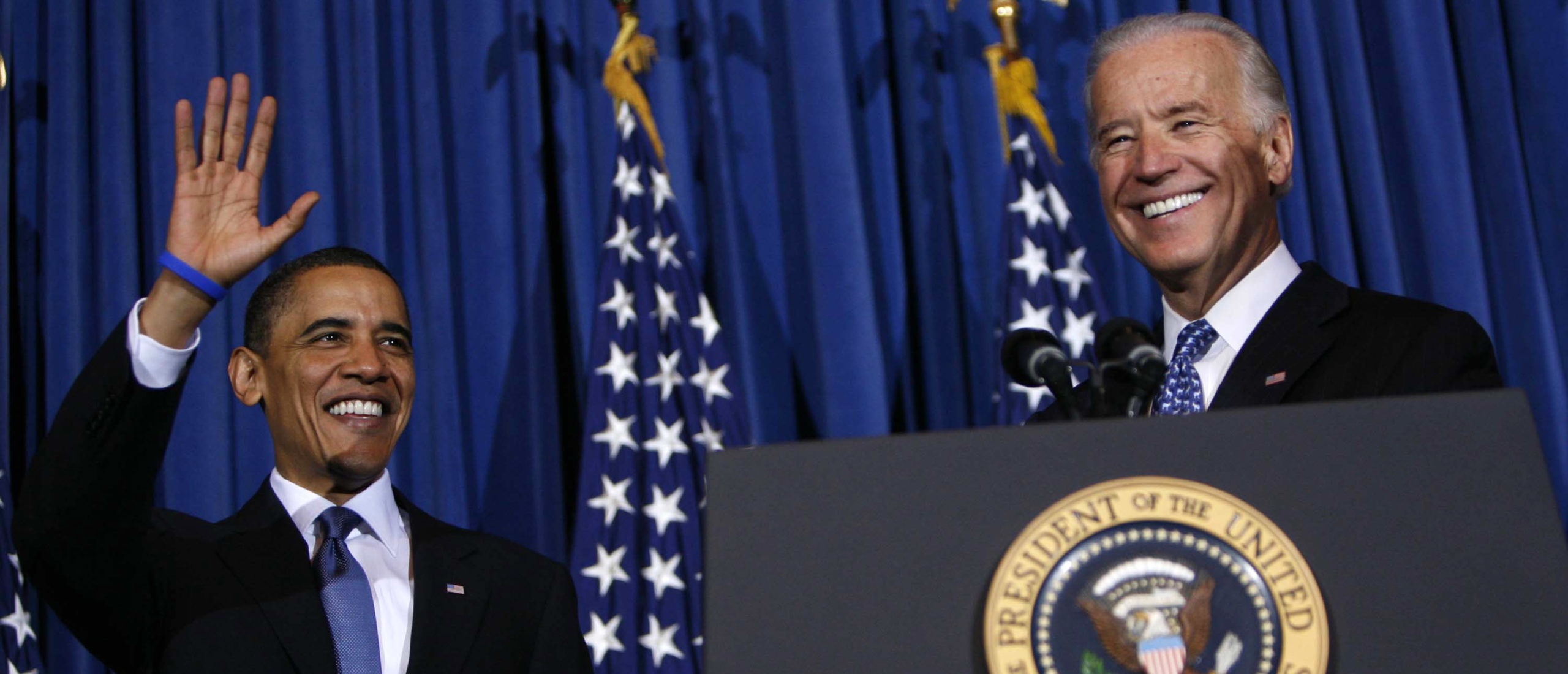 President Barack Obama and Vice President Joe Biden smile and wave at a rally celebrating the final passage of the Patient Protection and Affordable Care Act at the Department of the Interior March 23, 2010 in Washington, DC. (Dennis Brack-Pool/Getty Images)