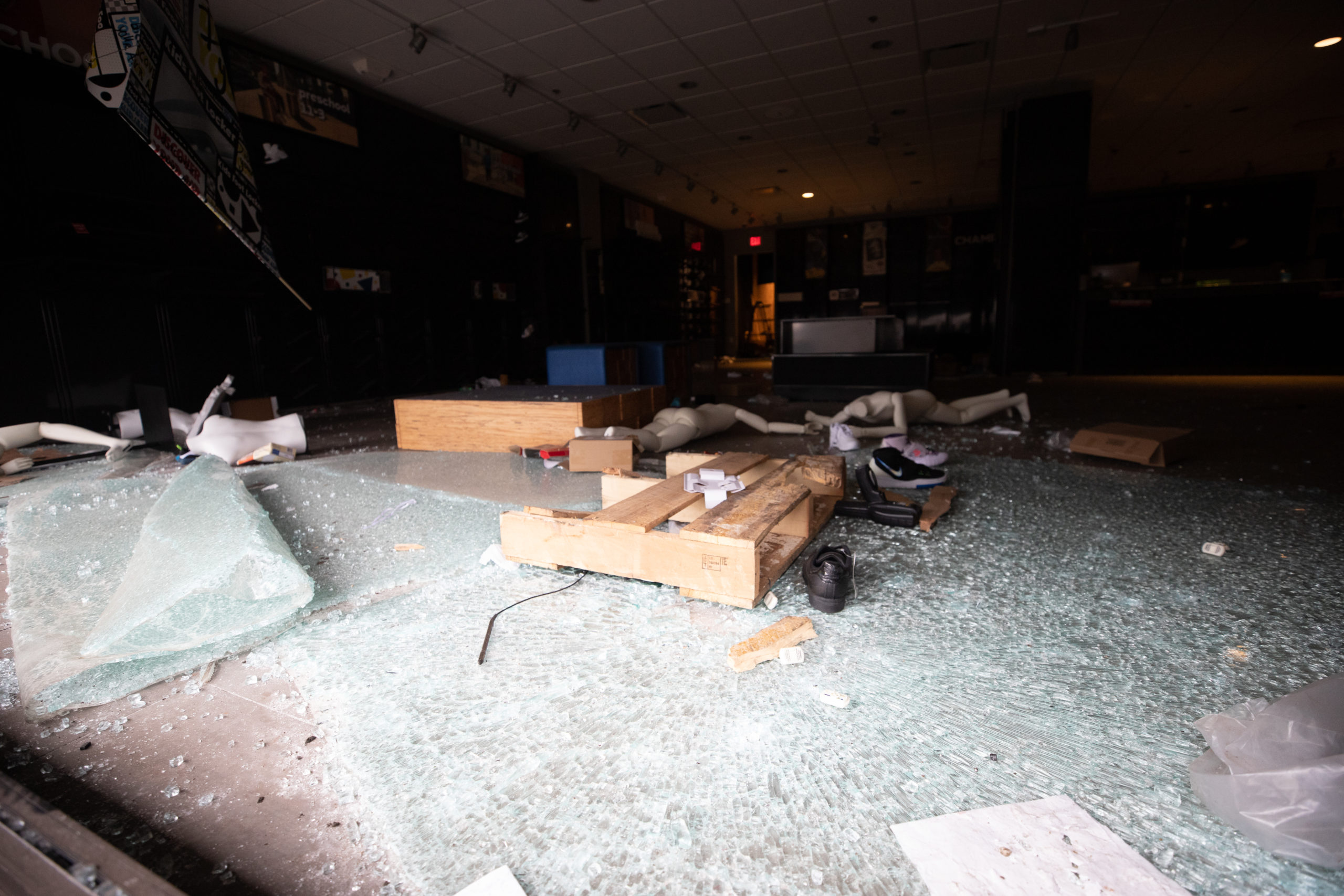 Police officers surveyed damage the morning after looters destroyed a Kids Footlocker located on Aramingo Ave. in Philadelphia, Pennsylvania, on Oct. 28, 2020. (Kaylee Greenlee - Daily Caller News Foundation.