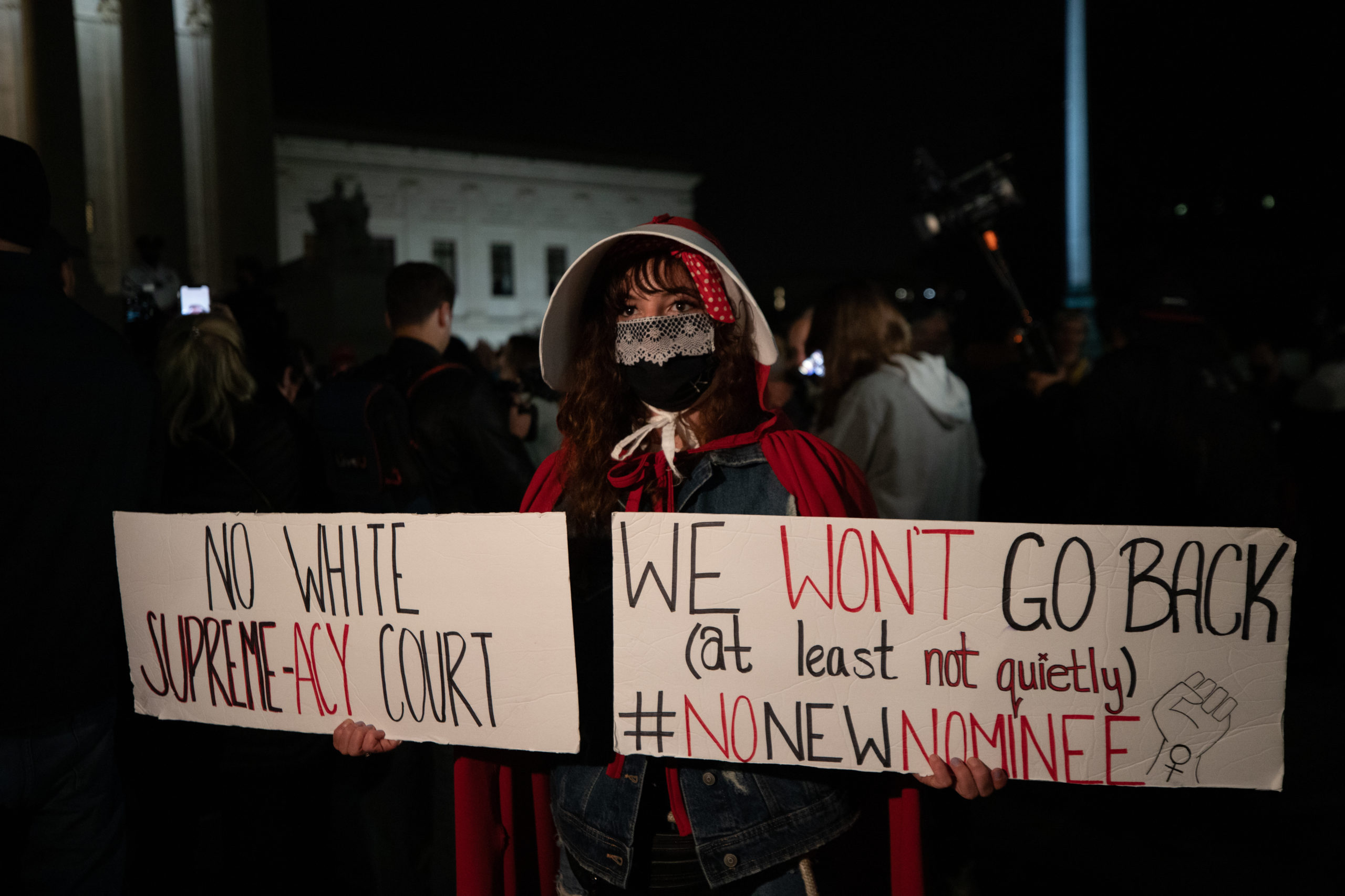 An anti-Amy Coney Barrett protester dressed as a handmaid just before the results of the Senate vote to confirm Amy Coney Barrett in Washington, D.C. on October 26, 2020. (Kaylee Greenlee - Daily Caller News Foundation)