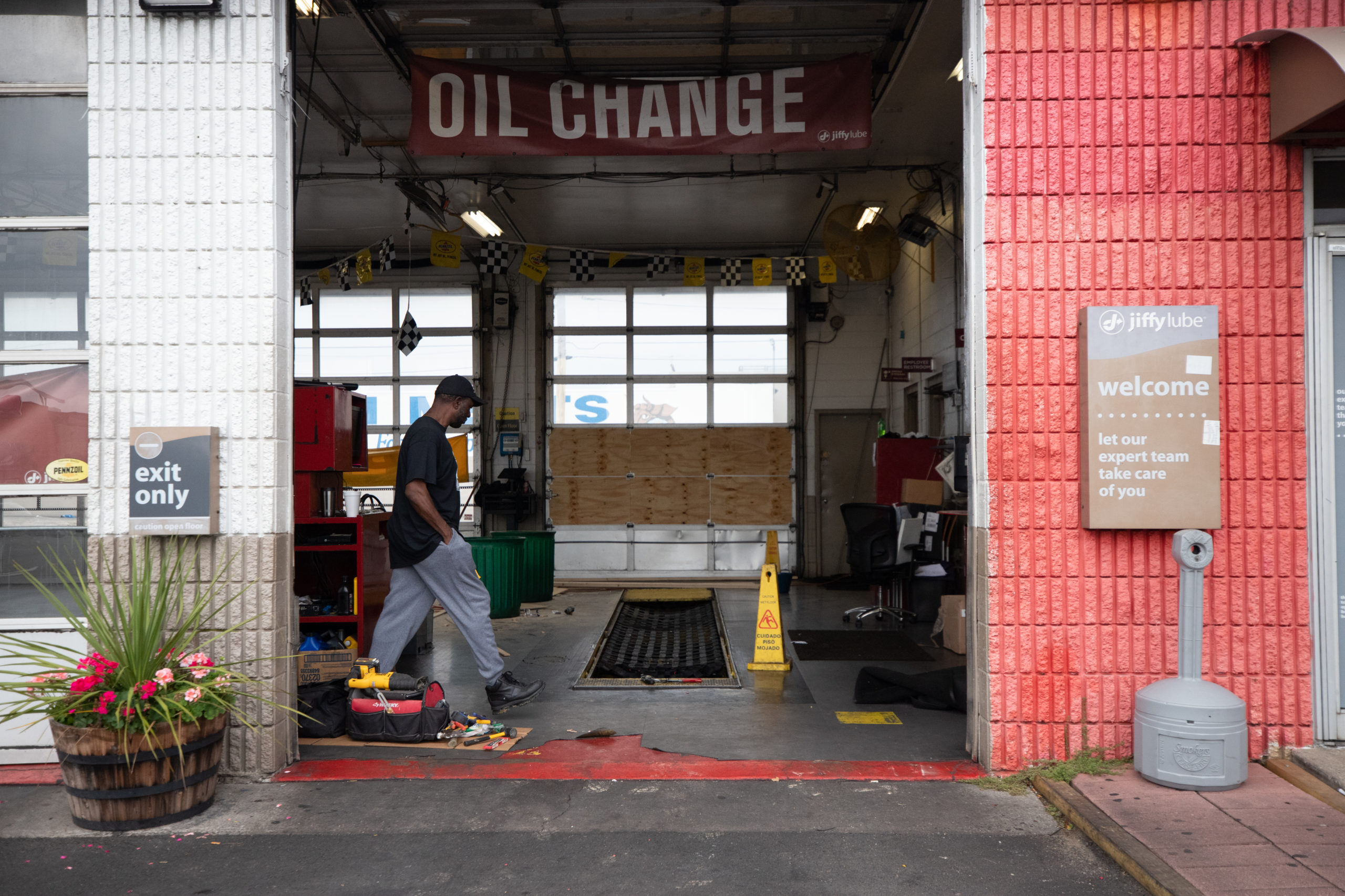 The owner of a Jiffy Lube auto shop on Aramingo Ave. in Philadelphia, Pennsylvania, surveyed damage done to his shop by looters on Oct. 28, 2020. (Kaylee Greenlee - Daily Caller News Foundation.