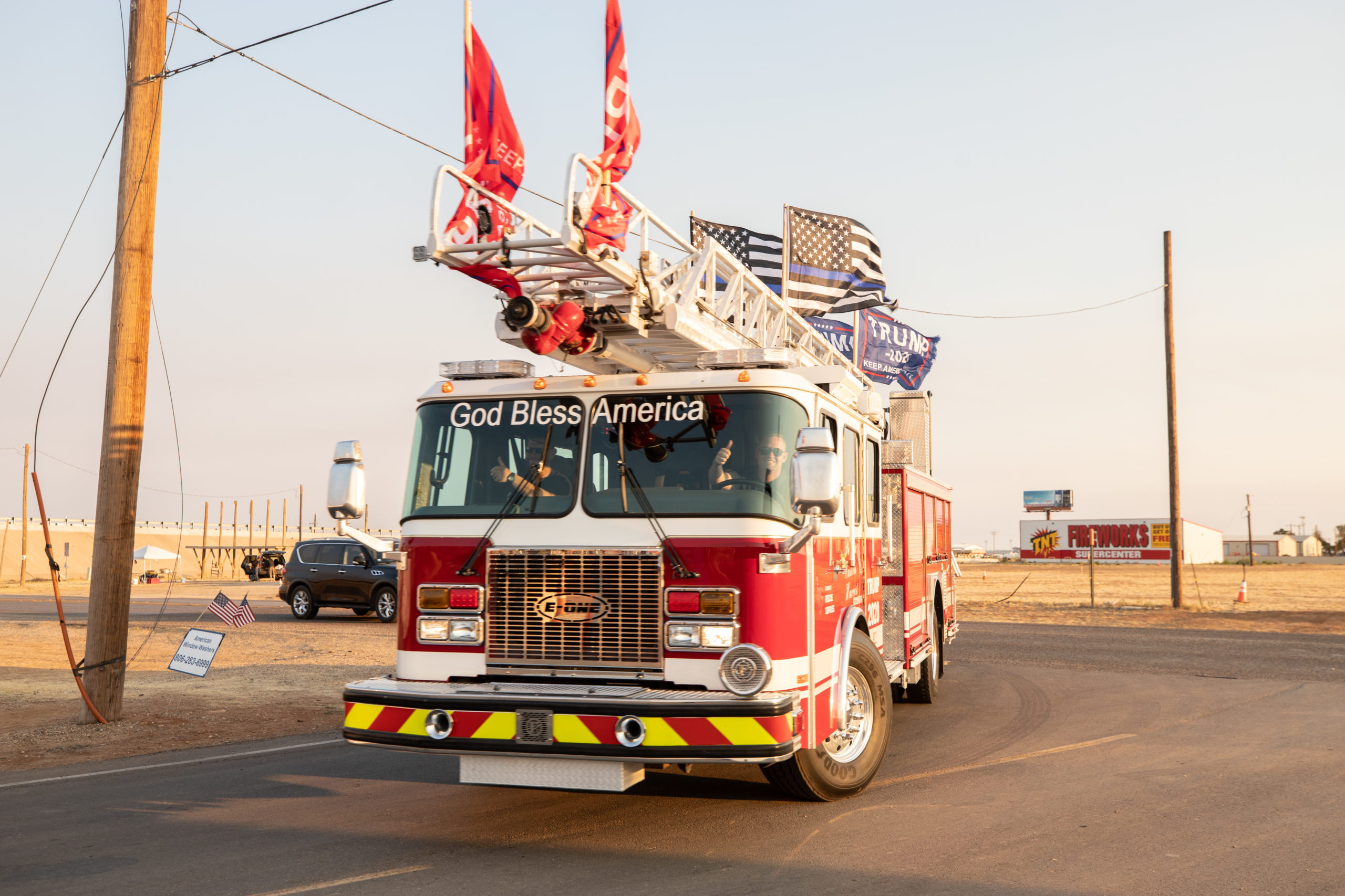 """A fire truck returns to Cook's Garage from a """"Trump Train"""" car parade in Lubbock, Texas, on Sunday, Oct. 18, 2020. (Kaylee Greenlee - DCNF)"""