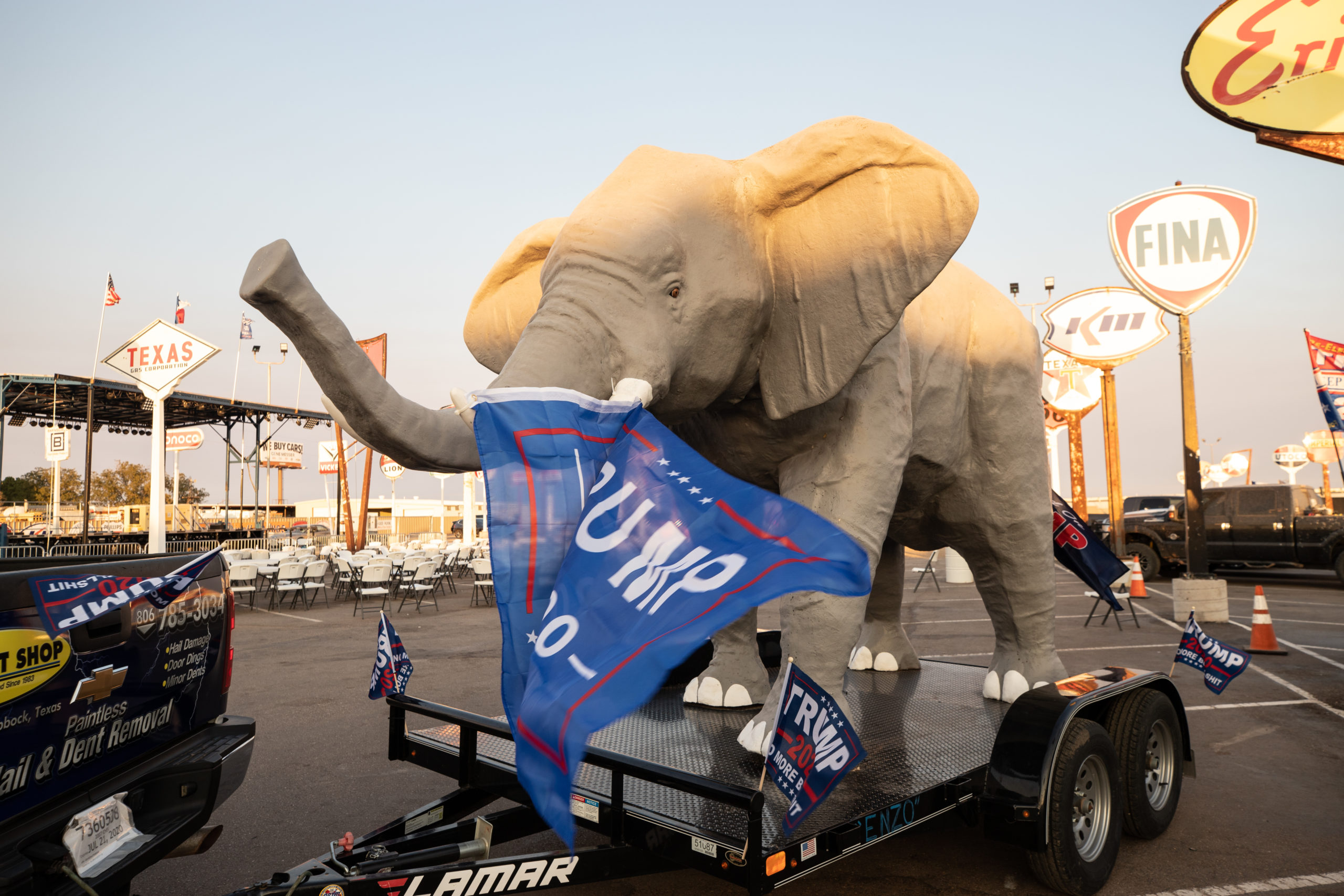 """A truck pulled a large elephant on a trailer with multiple Trump flags attached during a """"Trump Train"""" car parade in Lubbock, Texas, on Sunday, Oct. 18, 2020. (Kaylee Greenlee - DCNF)"""