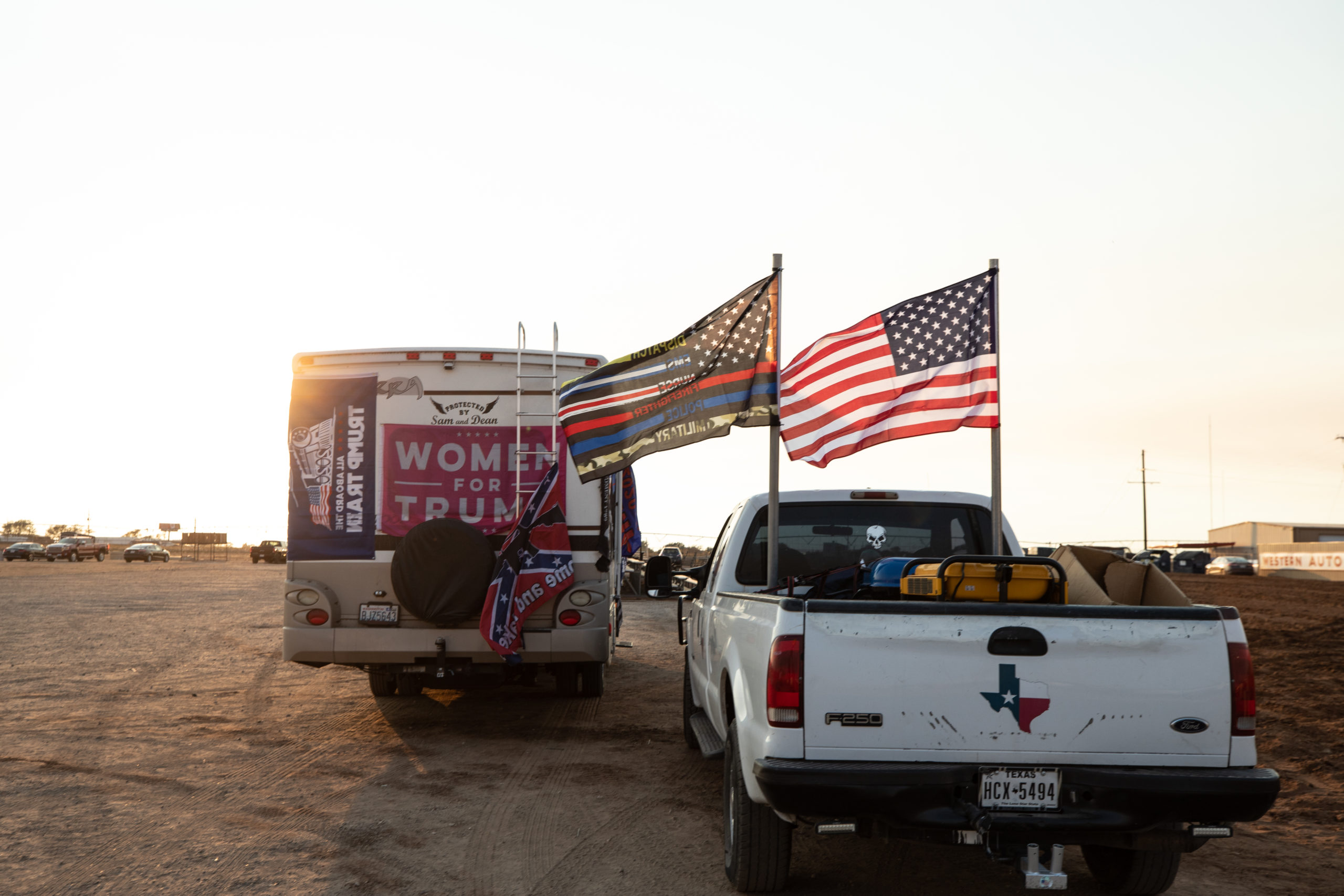 """A truck and camper remained at Cook's Garage after a """"Trump Train"""" car parade in Lubbock, Texas, on Sunday, Oct. 18, 2020. (Kaylee Greenlee - DCNF)"""
