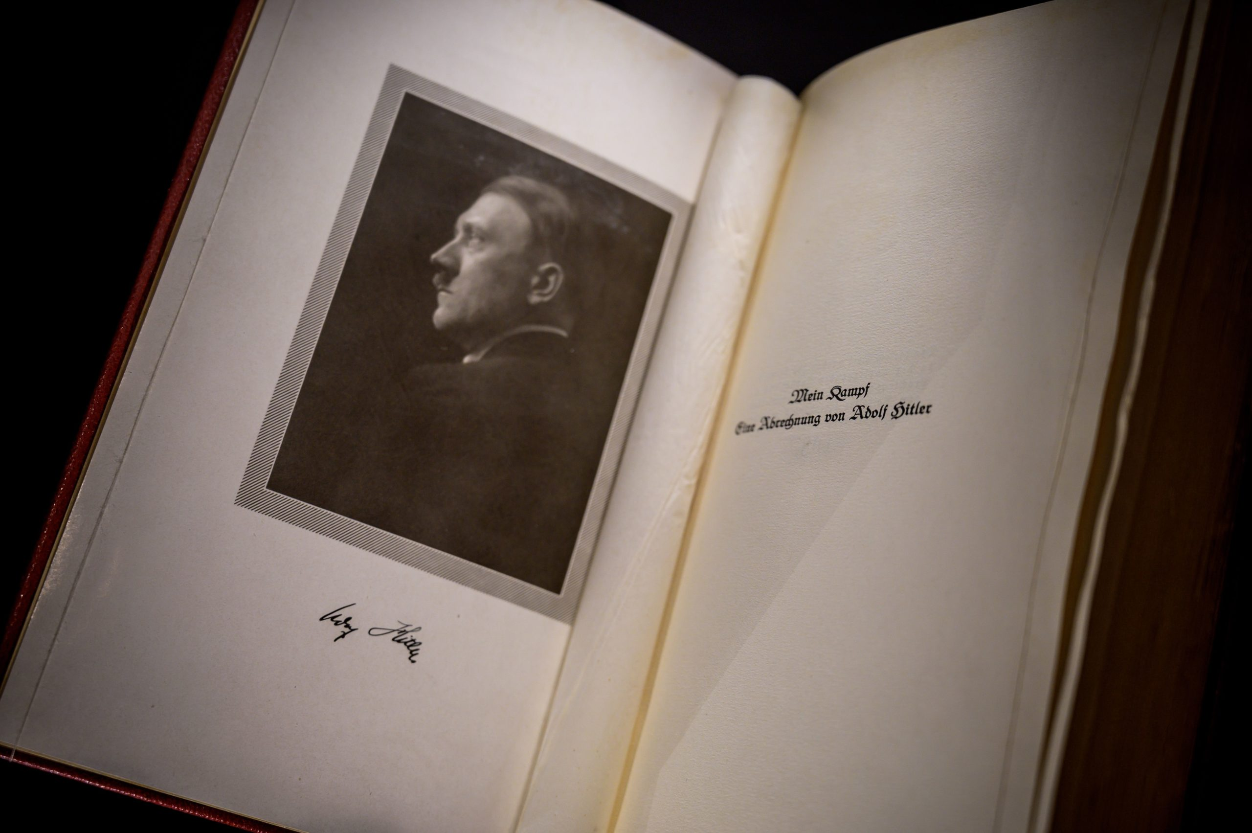 """An autographed original edition of Adolf Hitler's """"My fight"""" book is displayed at Martin Bodmer Foundation during the """"War and Peace"""" exhibition on October 11, 2019 in Cologny near Geneva. - Hitler's """"My fight"""" and a 5,000-year-old peace treaty -- the world's oldest -- represent opposite poles in the eternal human struggle between the propulsion to war and the desire for peace. (Photo by FABRICE COFFRINI / AFP) (Photo by FABRICE COFFRINI/AFP via Getty Images)"""