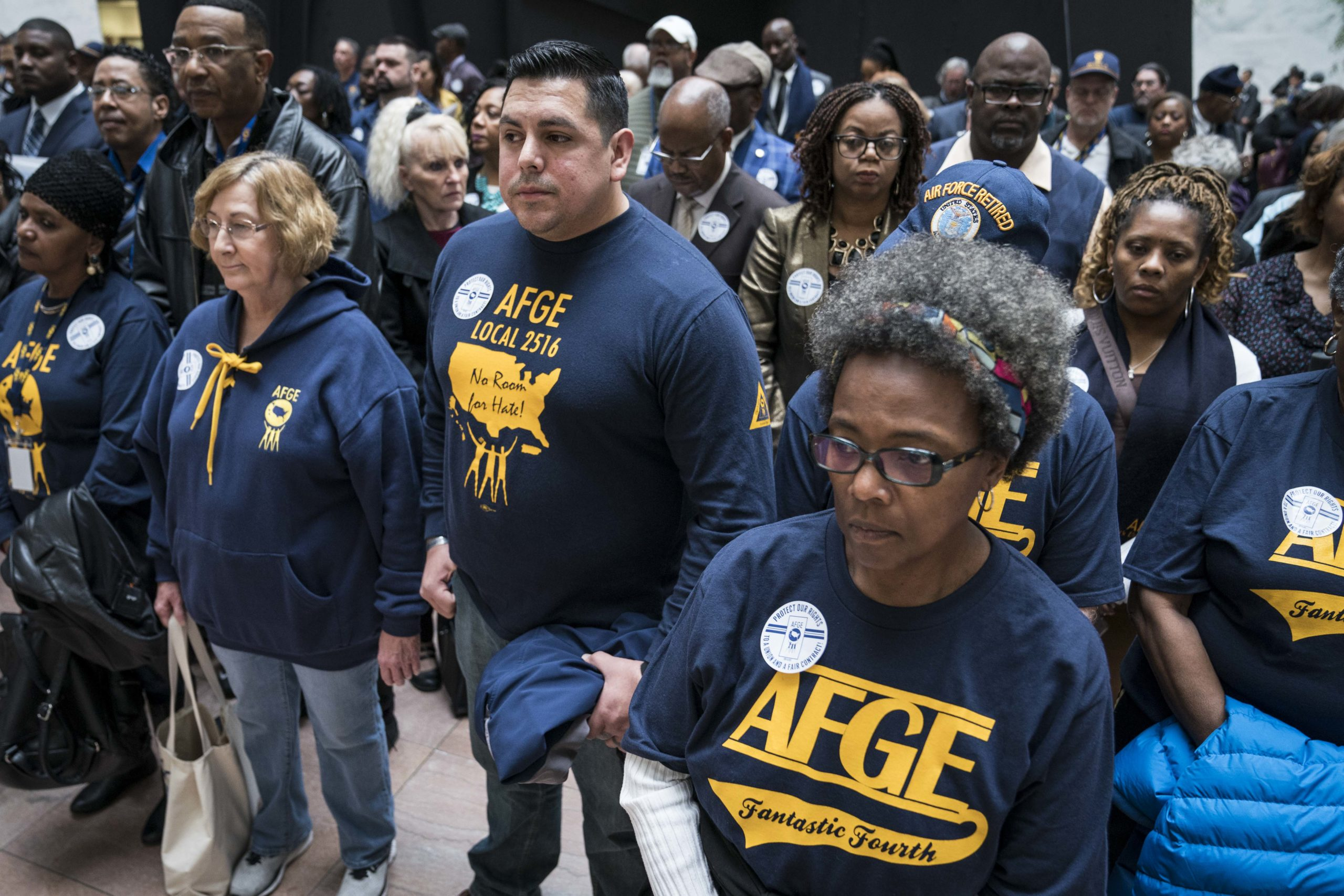 Members and supporters of the American Federation of Government Employees participate in a protest Washington, D.C. on Feb. 11. (Sarah Silbiger/Getty Images)