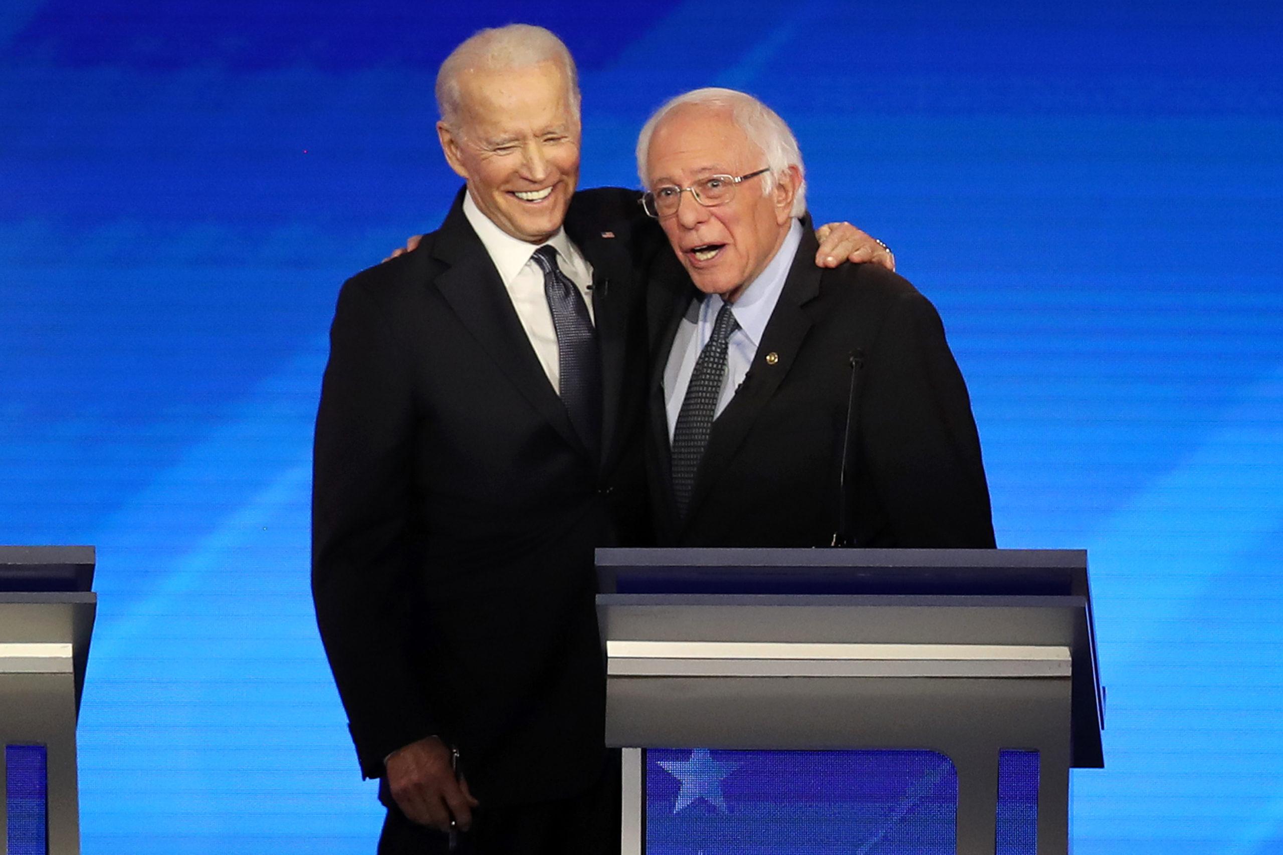 Vice President Joe Biden and Sen. Bernie Sanders embrace during the Democratic presidential primary debate on Feb. 7. (Joe Raedle/Getty Images)