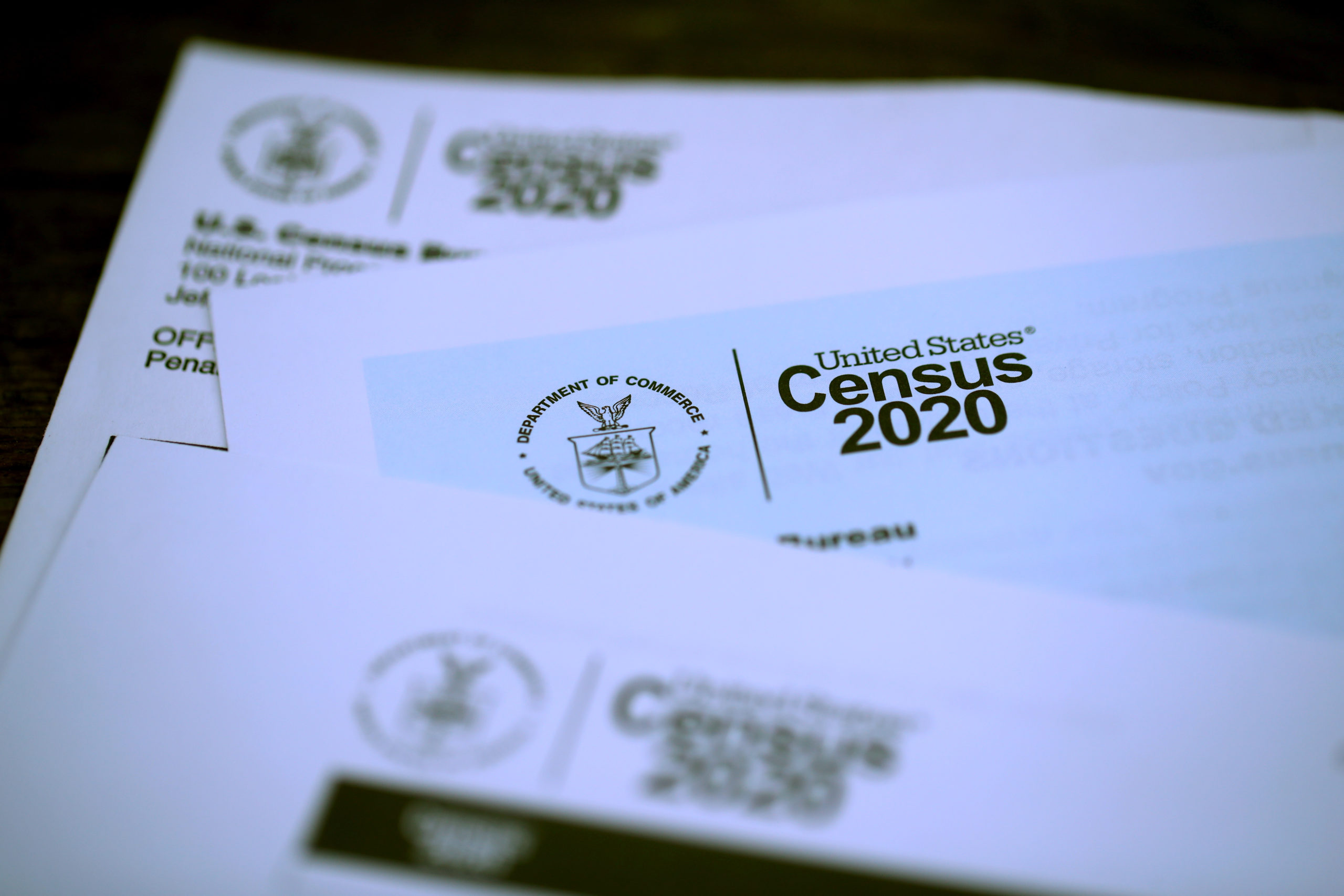 SAN ANSELMO, CALIFORNIA - MARCH 19: The U.S. Census logo appears on census materials received in the mail with an invitation to fill out census information online on March 19, 2020 in San Anselmo, California. The U.S. Census Bureau announced that it has suspended census field operations for the next two weeks over concerns of the census workers and their public interactions amid the global coronavirus pandemic. (Photo Illustration by Justin Sullivan/Getty Images)