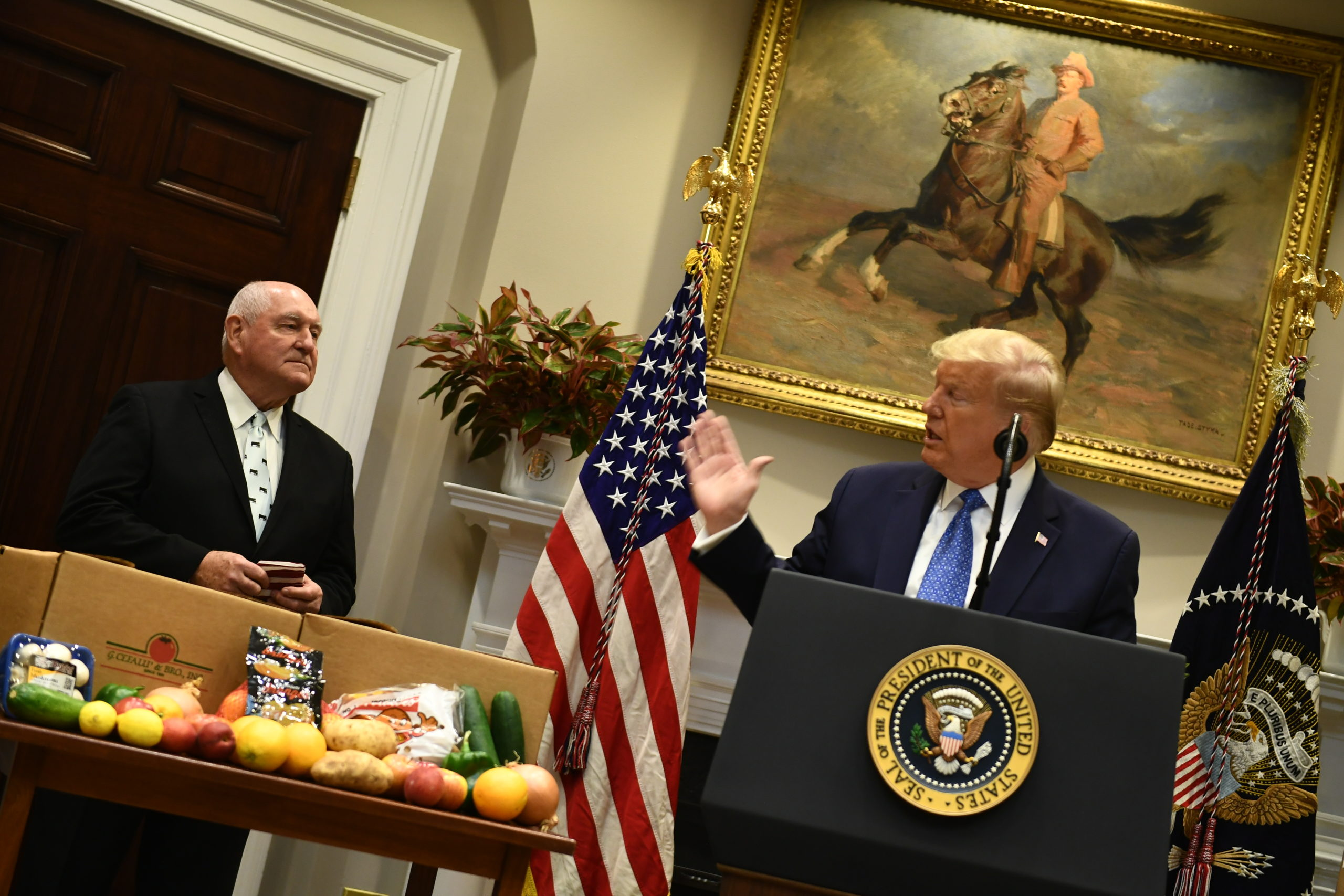 President Donald Trump, with Agriculture Sec. Sonny Perdue, speaks about the food supply chain during the coronavirus pandemic, in the Roosevelt Room of the White House on May 19. (Brendan Smialowski/AFP via Getty Images)