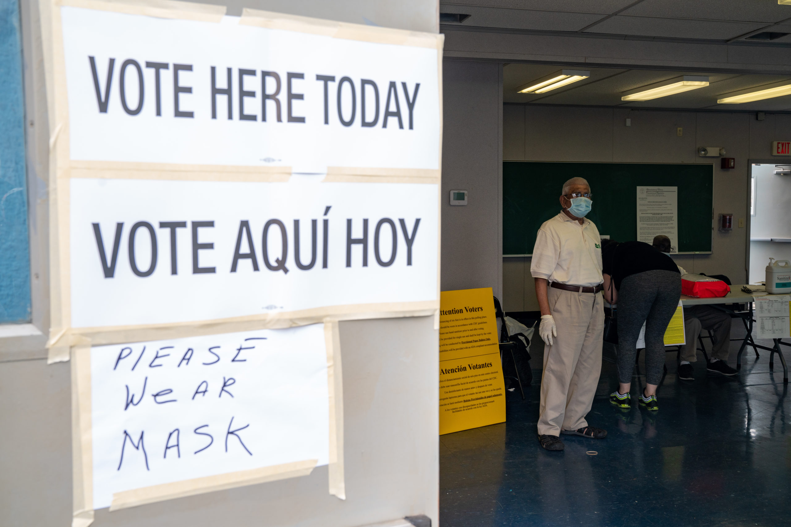 JERSEY CITY, NJ - JULY 07: A poll worker at Liberty High School on July 7, 2020 in Jersey City, New Jersey. New Jersey residents will choose their candidates for president, Senate and House but because of the pandemic most are casting their votes by mail-in ballots. (Photo by David Dee Delgado/Getty Images)