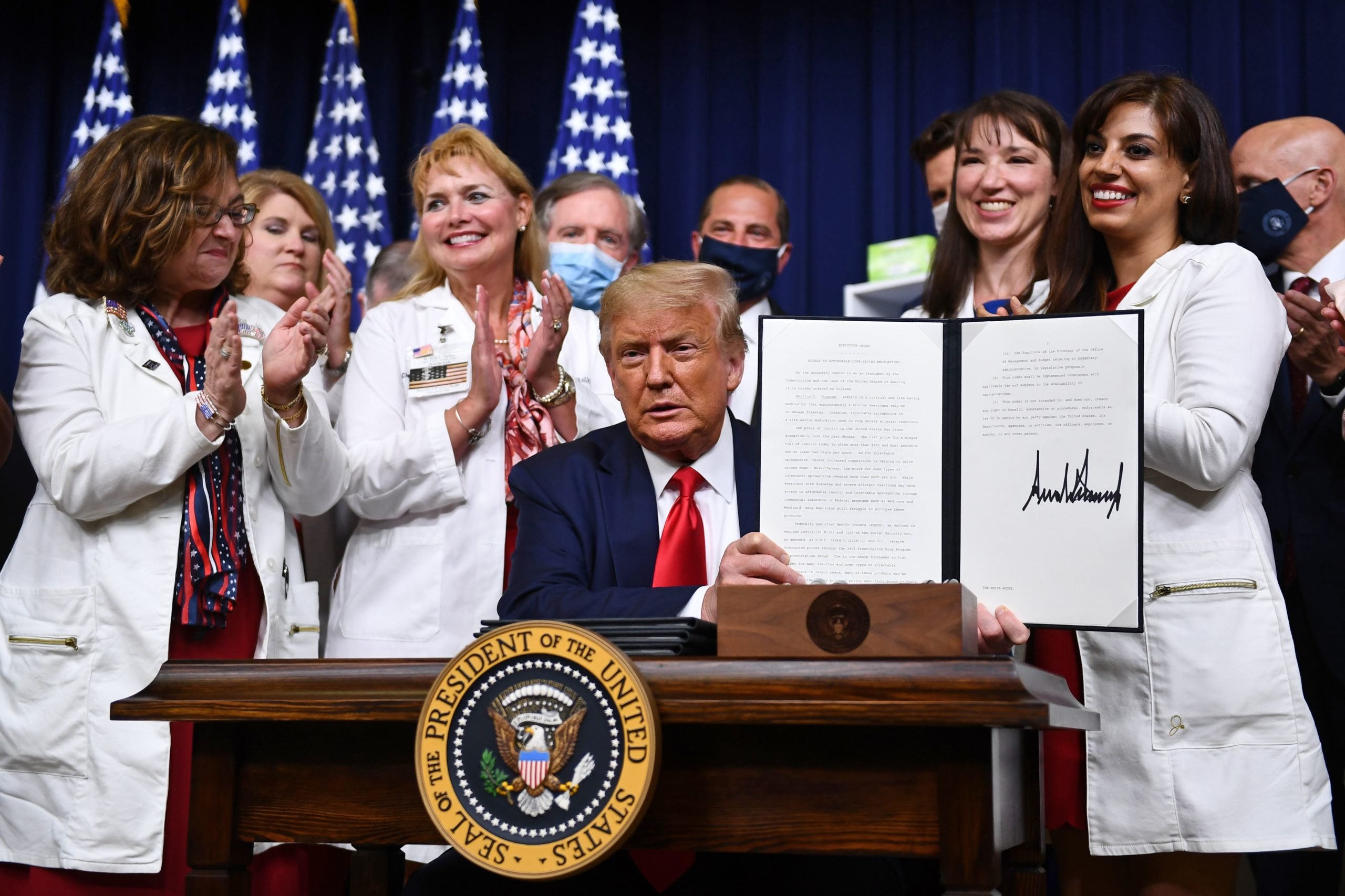 US President Donald Trump signs an executive order on lowering drug prices at the White House, in Washington, DC on July 24, 2020. (BRENDAN SMIALOWSKI/AFP via Getty Images)