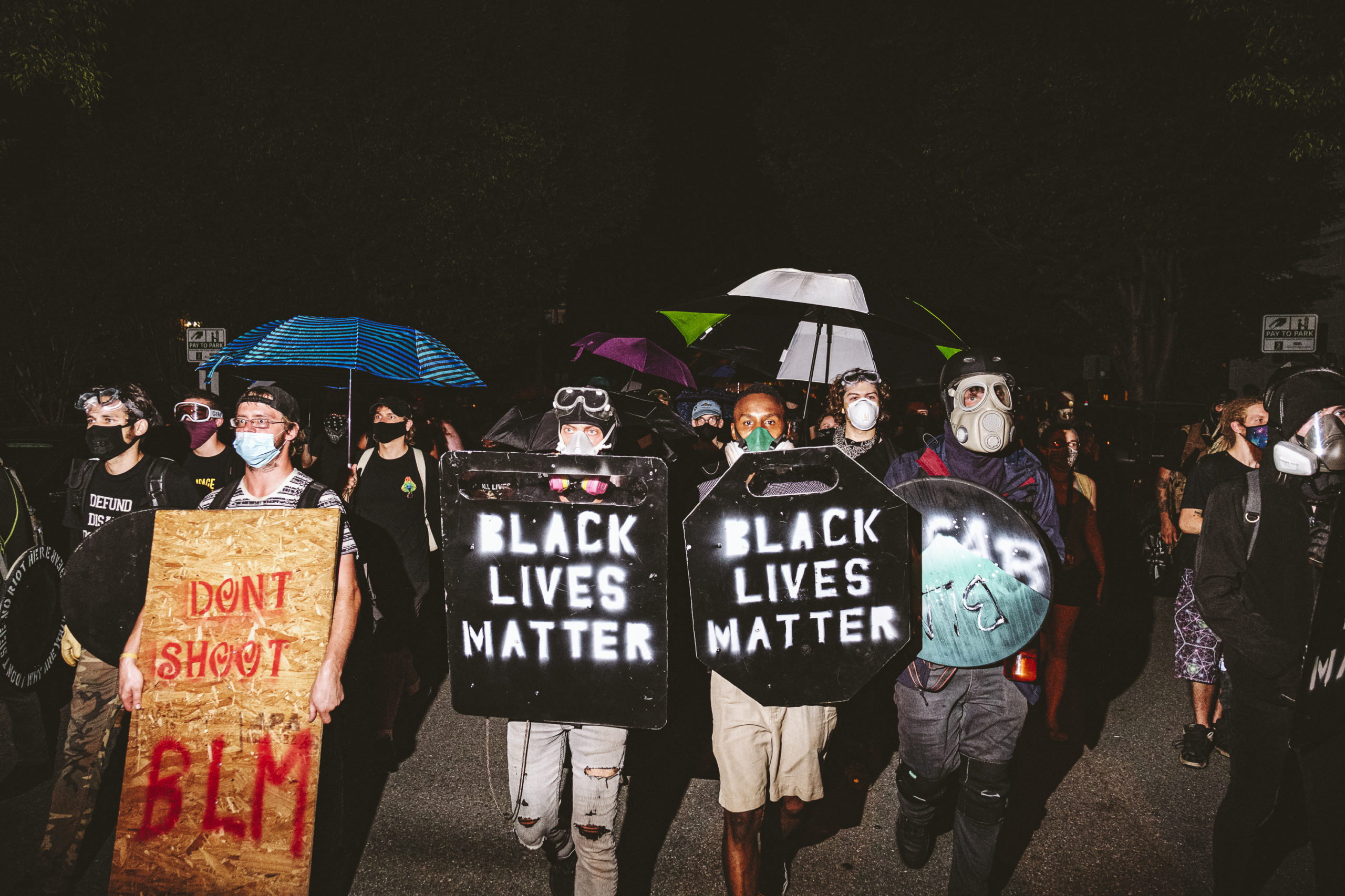 RICHMOND, VA - JULY 25: People carrying homemade Black Lives Matter shields march in front of protesters on July 25, 2020 in Richmond, Virginia. Protesters in Richmond took to the streets to join other protesters around the country for the Stand With Portland rally in support of the Black Lives Matter protesters in Portland, Oregon. (Eze Amos/Getty Images)