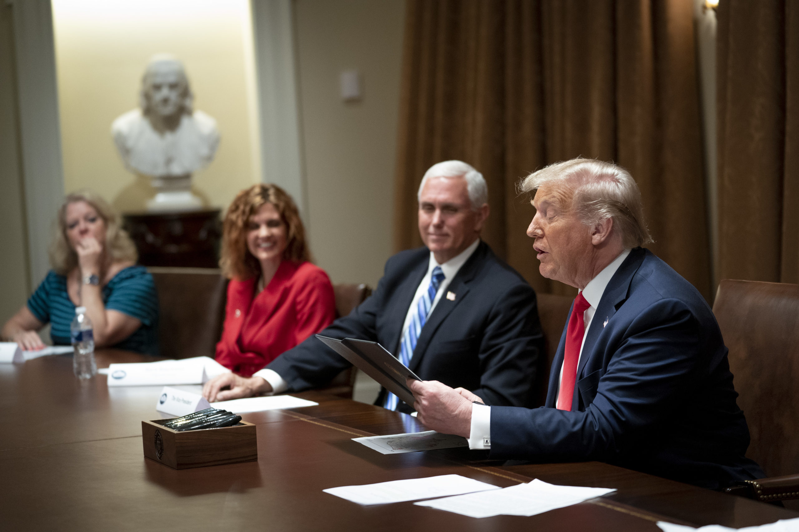 President Donald Trump makes remarks as he meets with U.S. Tech Workers and signs an Executive Order on Hiring Americans, in the White House on Aug. 3. (Doug Mills/Pool/Getty Images)