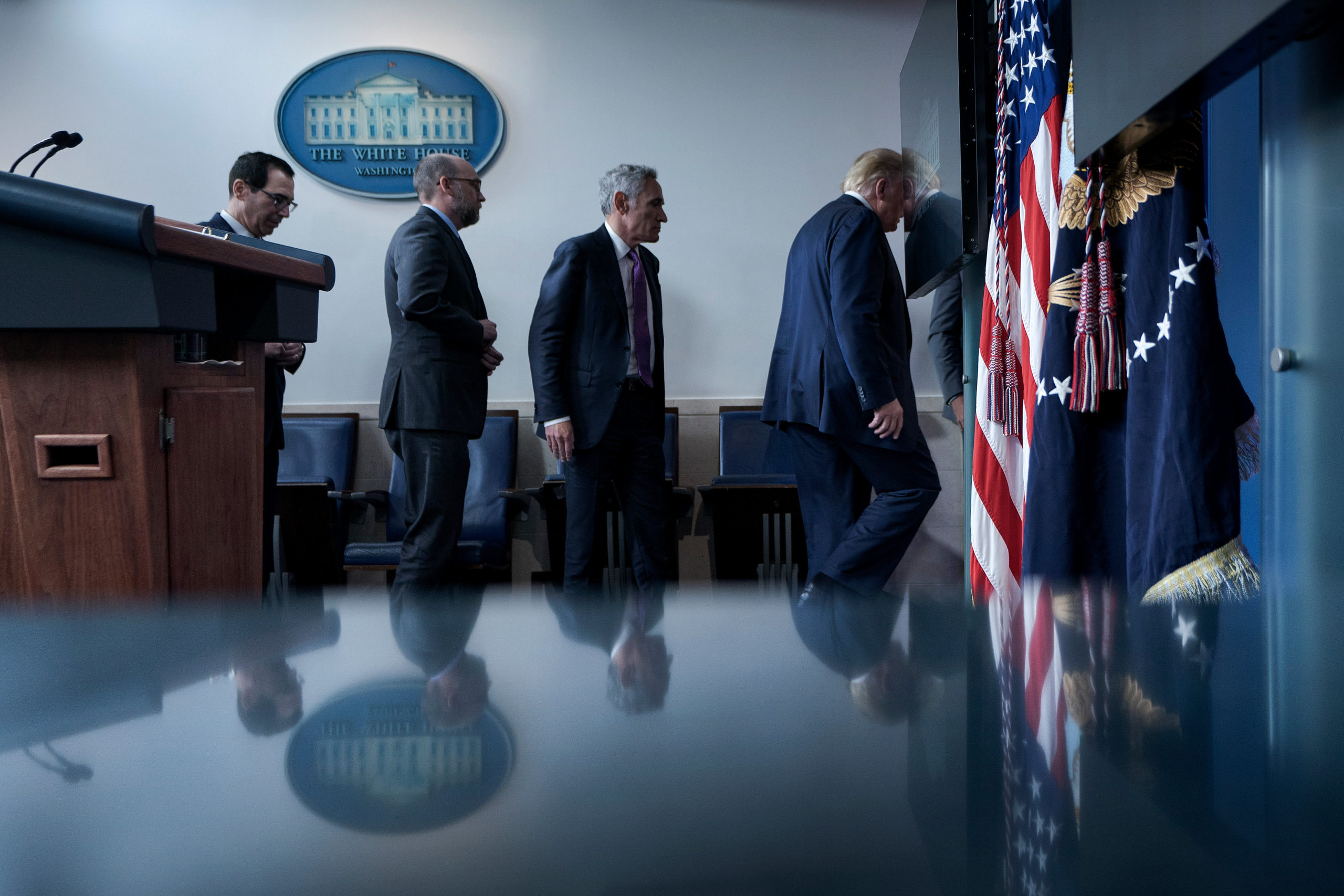 Dr. Scott Atlas follows President Donald Trump as they leave a White House briefing on Aug. 10. (Brendan Smialowski/AFP via Getty Images)