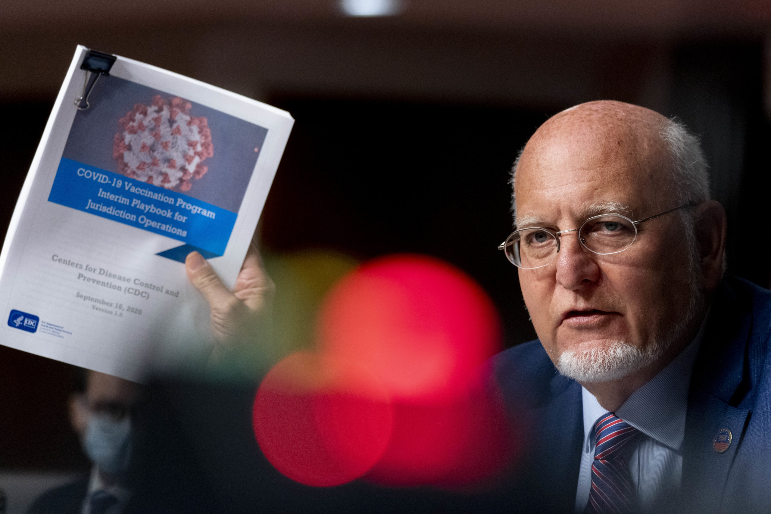 Centers for Disease Control and Prevention (CDC) Director Dr. Robert Redfield holds up a CDC document while he speaks at a hearing of the Senate Appropriations subcommittee reviewing coronavirus response efforts on September 16, 2020 in Washington, DC. (Andrew Harnik-Pool/Getty Images)
