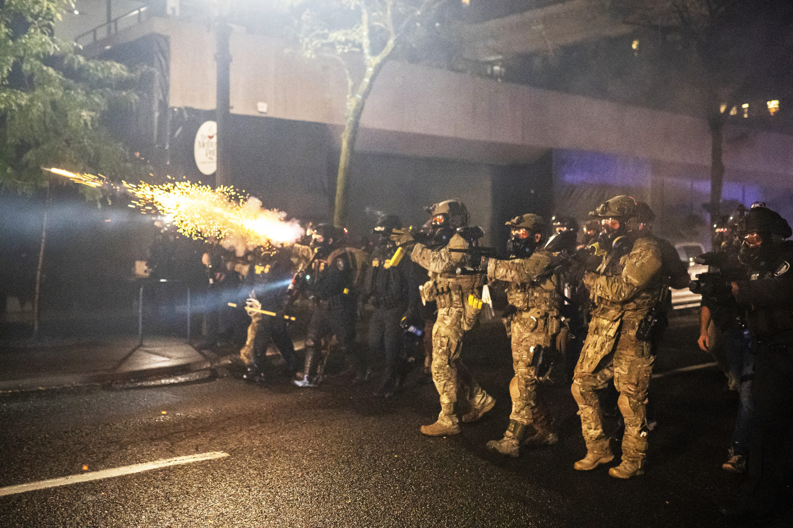 PORTLAND, OR - SEPTEMBER 23: Federal officers disperse a crowd on September 23, 2020 in Portland, United States. Violent protests erupted across the nation Wednesday following the results of a grand jury investigation into the police shooting death of Breonna Taylor. (Nathan Howard/Getty Images)