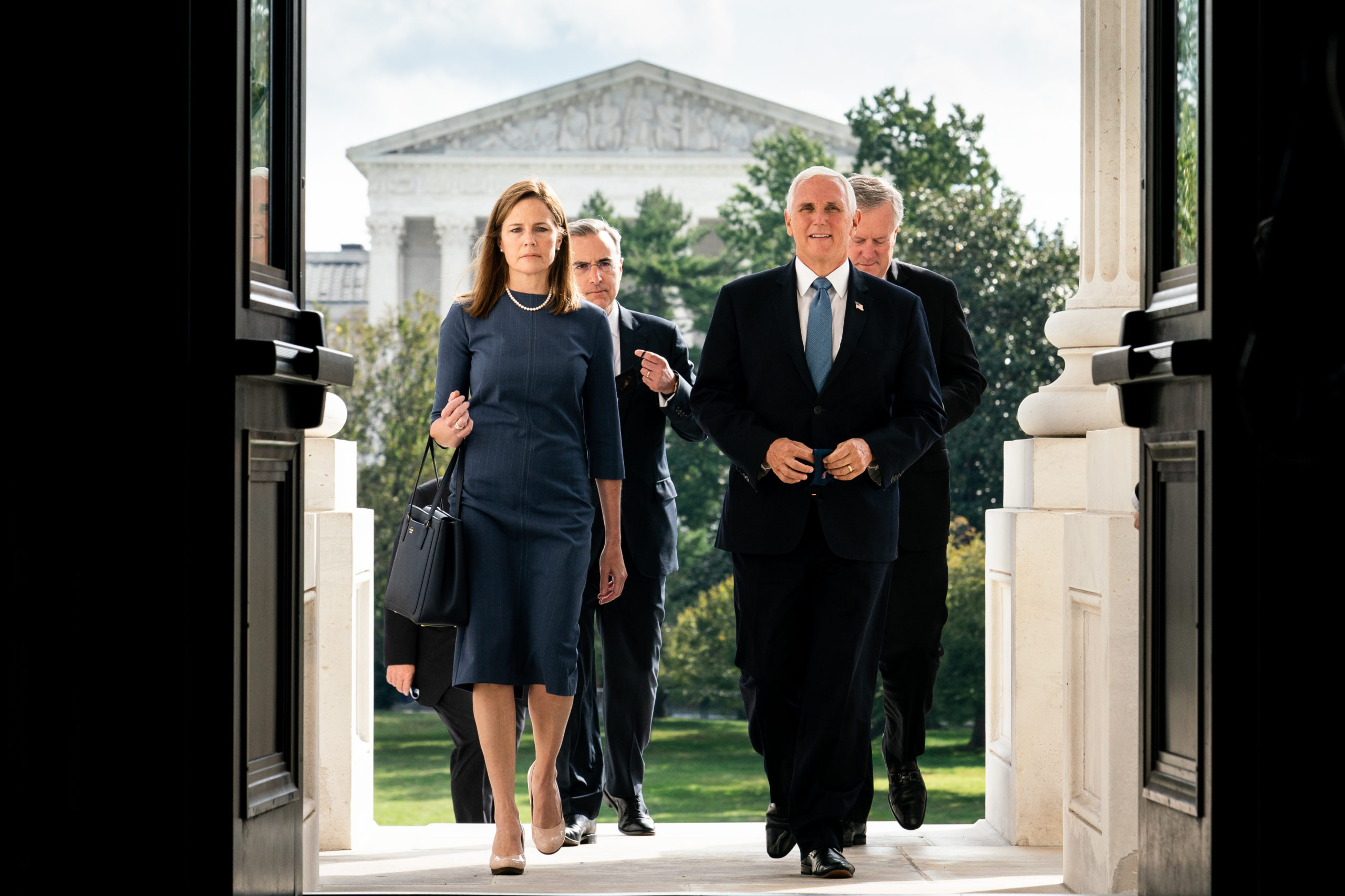 WASHINGTON, DC - SEPTEMBER 29: Seventh U.S. Circuit Court Judge Amy Coney Barrett, President Donald Trump's nominee for the U.S. Supreme Court, and Vice President Mike Pence arrive at the U.S. Capitol where Barrett is attending a series of meetings in preparation for her confirmation hearing, on September 29, 2020 in Washington, DC. (Erin Schaff-Pool/Getty Images)