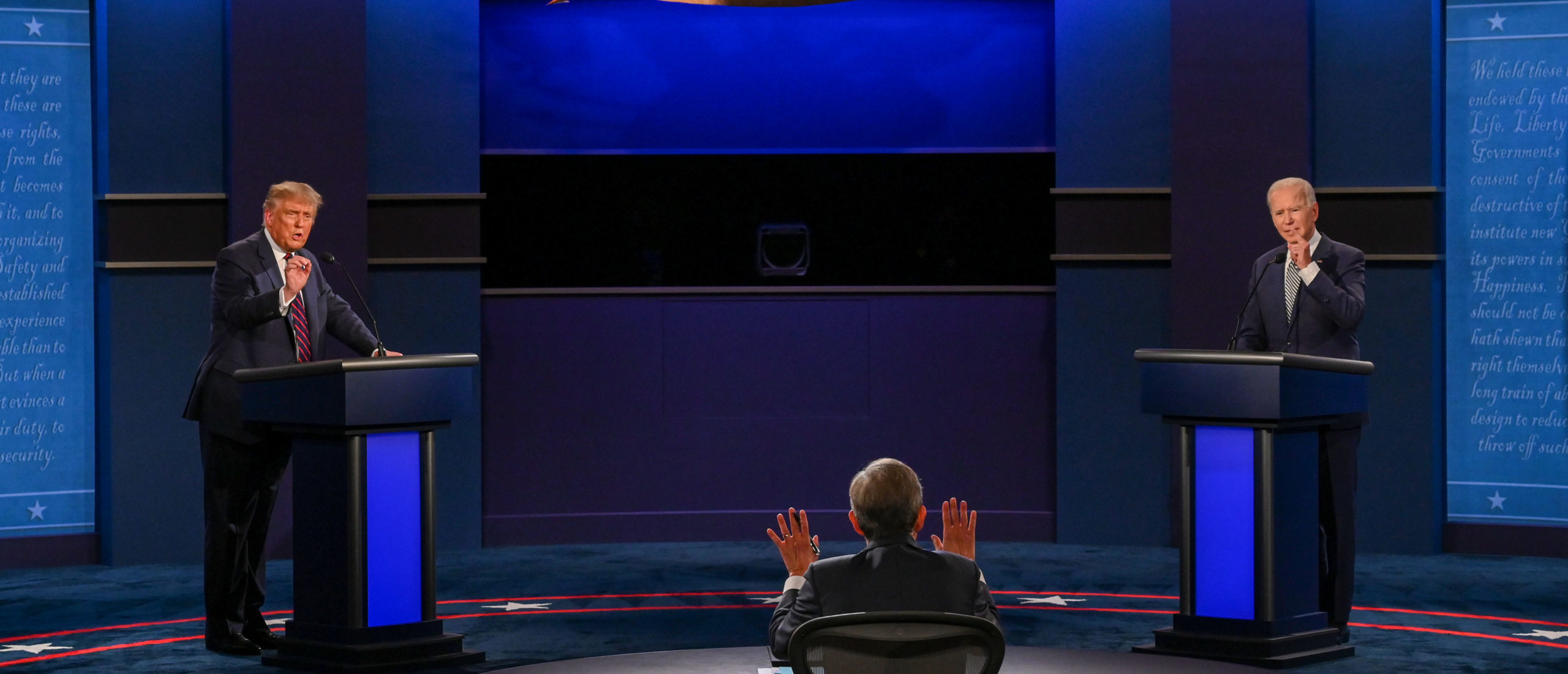 US President Donald Trump and Democratic Presidential candidate and former US Vice President Joe Biden exchange arguments as moderator and Fox News anchor Chris Wallace (C) raises his hands to stop them during the first presidential debate at Case Western Reserve University and Cleveland Clinic in Cleveland, Ohio, on September 29, 2020. (Photo by Jim Watson/AFP via Getty Images)