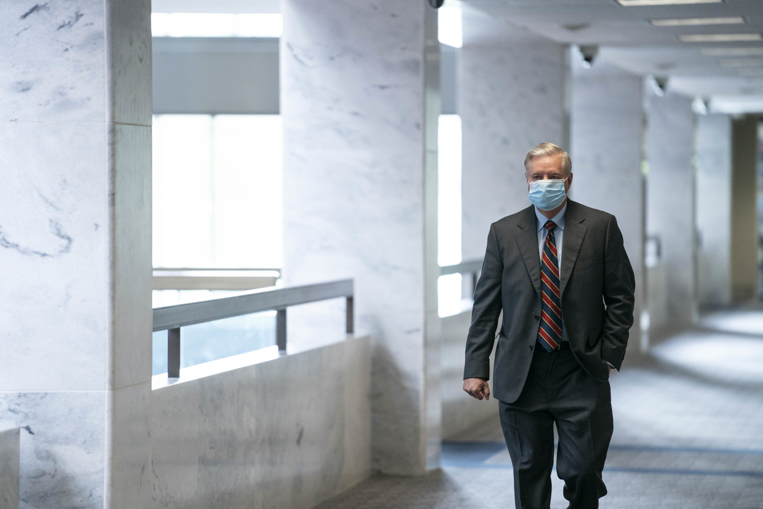 Sen. Lindsey Graham walks to a Republican caucus luncheon in the Hart Senate Office Building on Oct. 23. (Sarah Silbiger/Getty Images)
