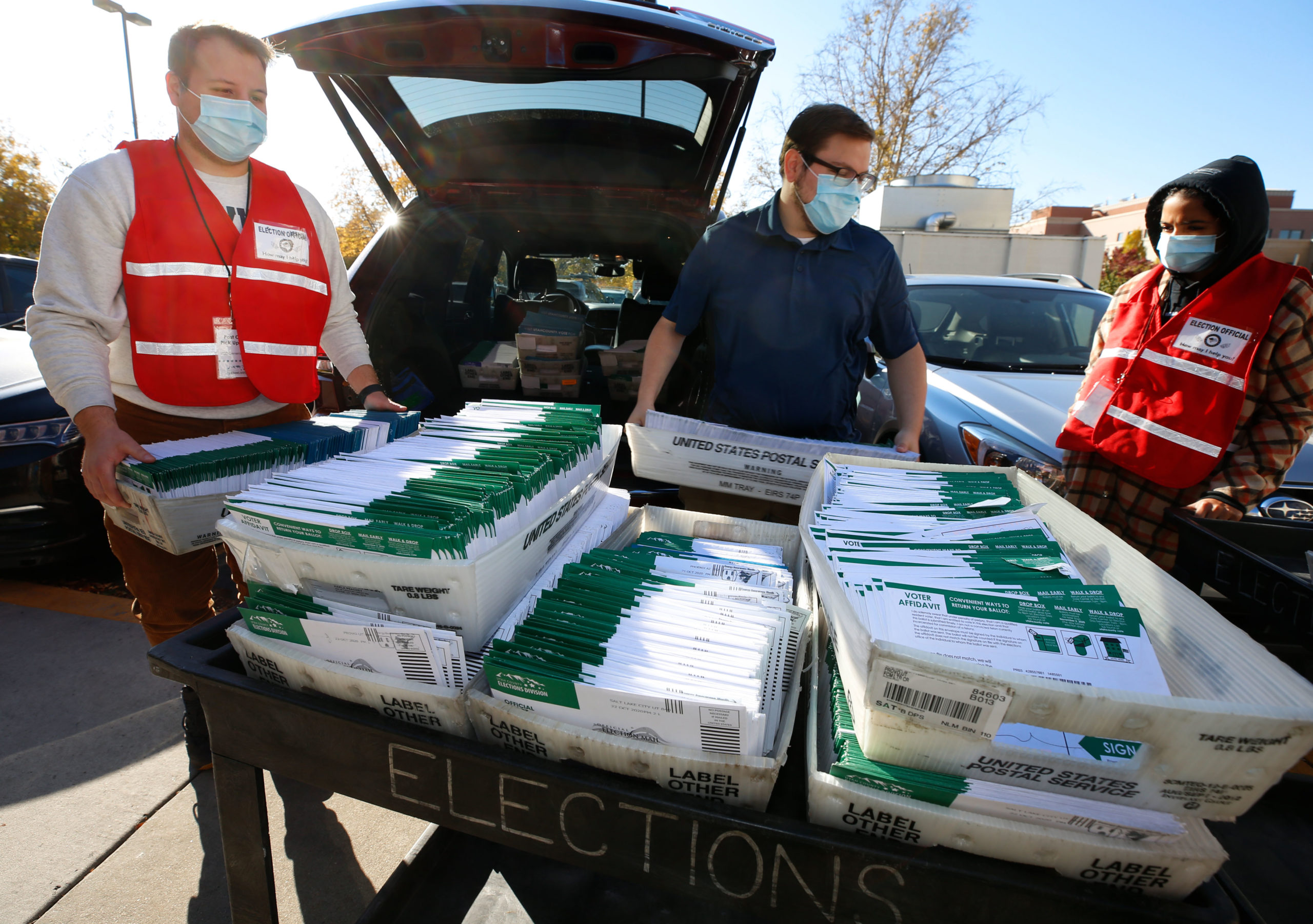 Utah County Election workers unload ballots that were picked up at a United States Postal Service office on Monday in Provo, Utah. (George Frey/Getty Images)