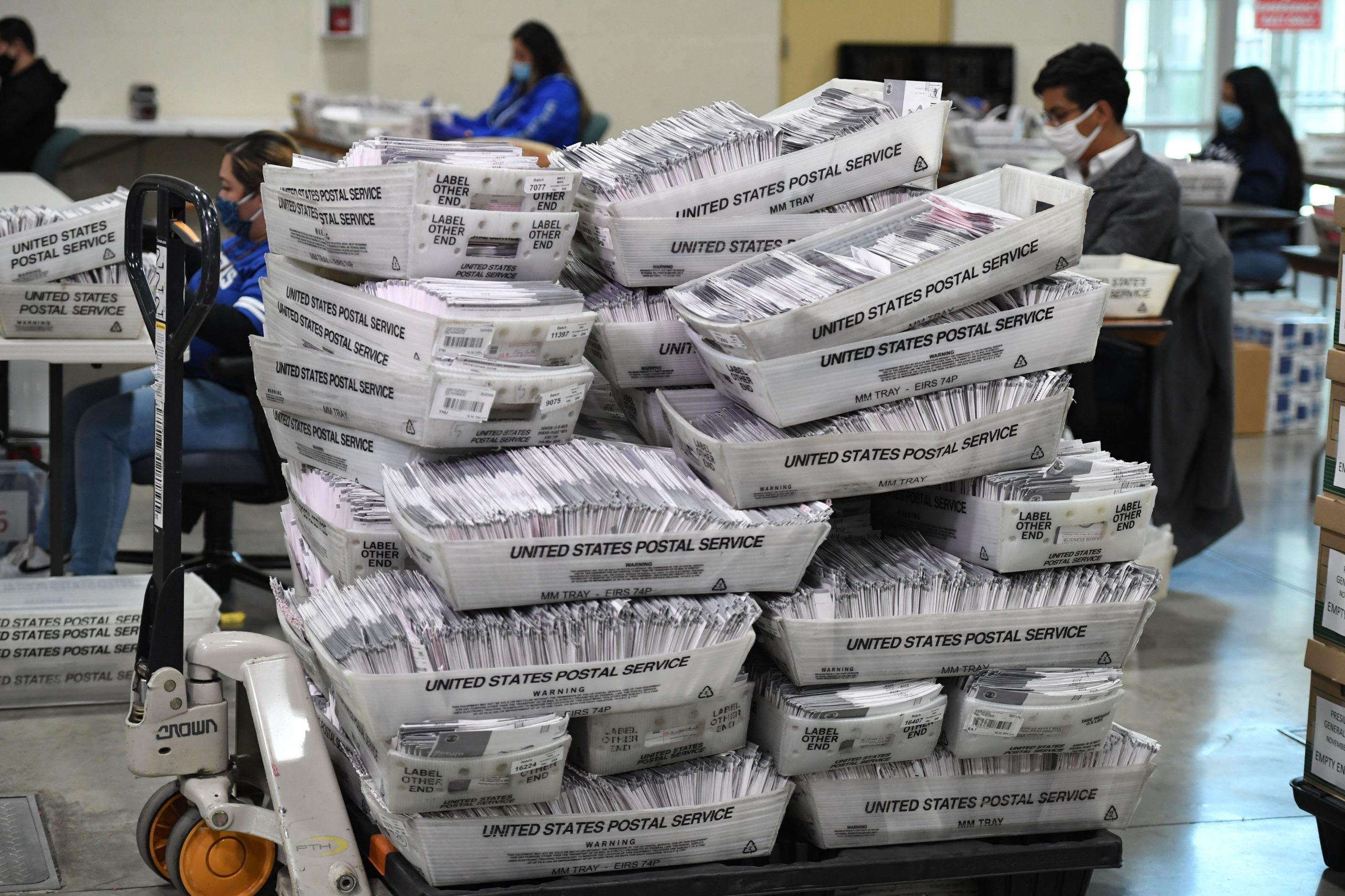 Bins of mail-in ballots await distribution at the Los Angeles County Registrar Recorders' mail-in ballot processing center on Oct. 28. (Robyn Beck/AFP via Getty Images)