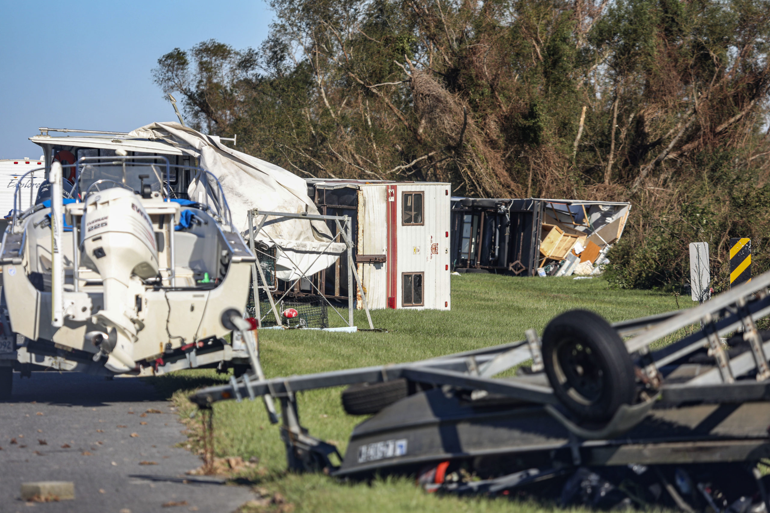 Overturned trailers sit along LA-46 after Hurricane Zeta on October 29, 2020 in Reggio, Louisiana. A record seven hurricanes have hit the gulf coast in 2020 bringing prolonged destruction to the area. (Photo by Sandy Huffaker/Getty Images)