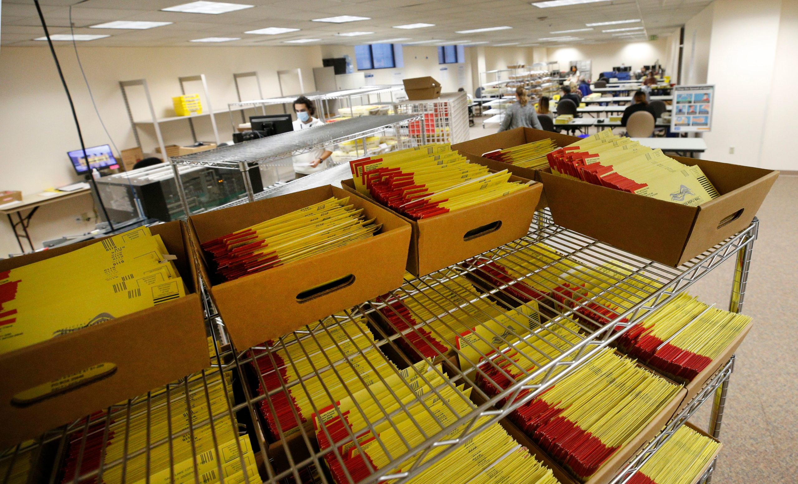 Stacks of mail-in ballots wait to be processed by election workers at the election office in Salt Lake City, Utah on Oct. 29. (George Frey/AFP via Getty Images)