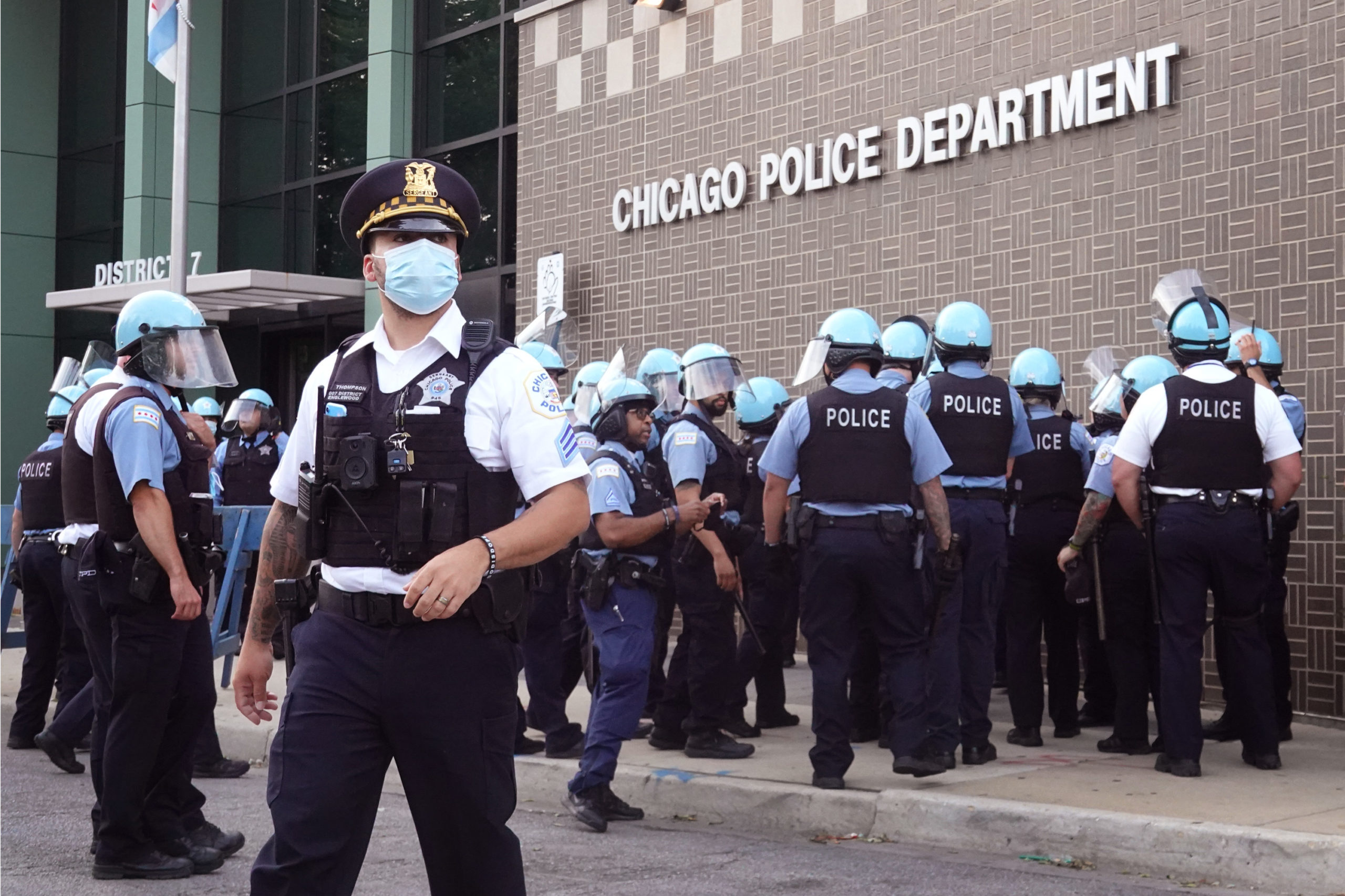 CHICAGO, ILLINOIS - AUGUST 11: Chicago police stand guard as demonstrators protest outside the department's 7th District station on August 11, 2020 in Chicago, Illinois. The protest was held in response to the August 9 shooting and wounding of a 20-year-old man who allegedly fired at officers in the Englewood neighborhood. The protest was met with resistance from a small group of Englewood residents. (Scott Olson/Getty Images)