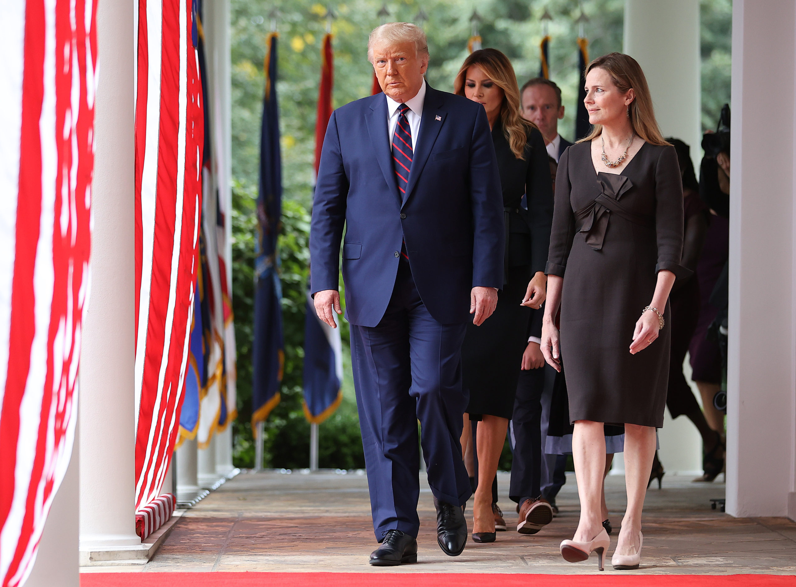 WASHINGTON, DC - SEPTEMBER 26: U.S. President Donald Trump (L) arrives to introduce 7th U.S. Circuit Court Judge Amy Coney Barrett as his nominee to the Supreme Court in the Rose Garden at the White House September 26, 2020 in Washington, DC. With 38 days until the election, Trump tapped Barrett to be his third Supreme Court nominee in just four years and to replace the late Associate Justice Ruth Bader Ginsburg, who will be buried at Arlington National Cemetery on Tuesday. (Photo by Chip Somodevilla/Getty Images)