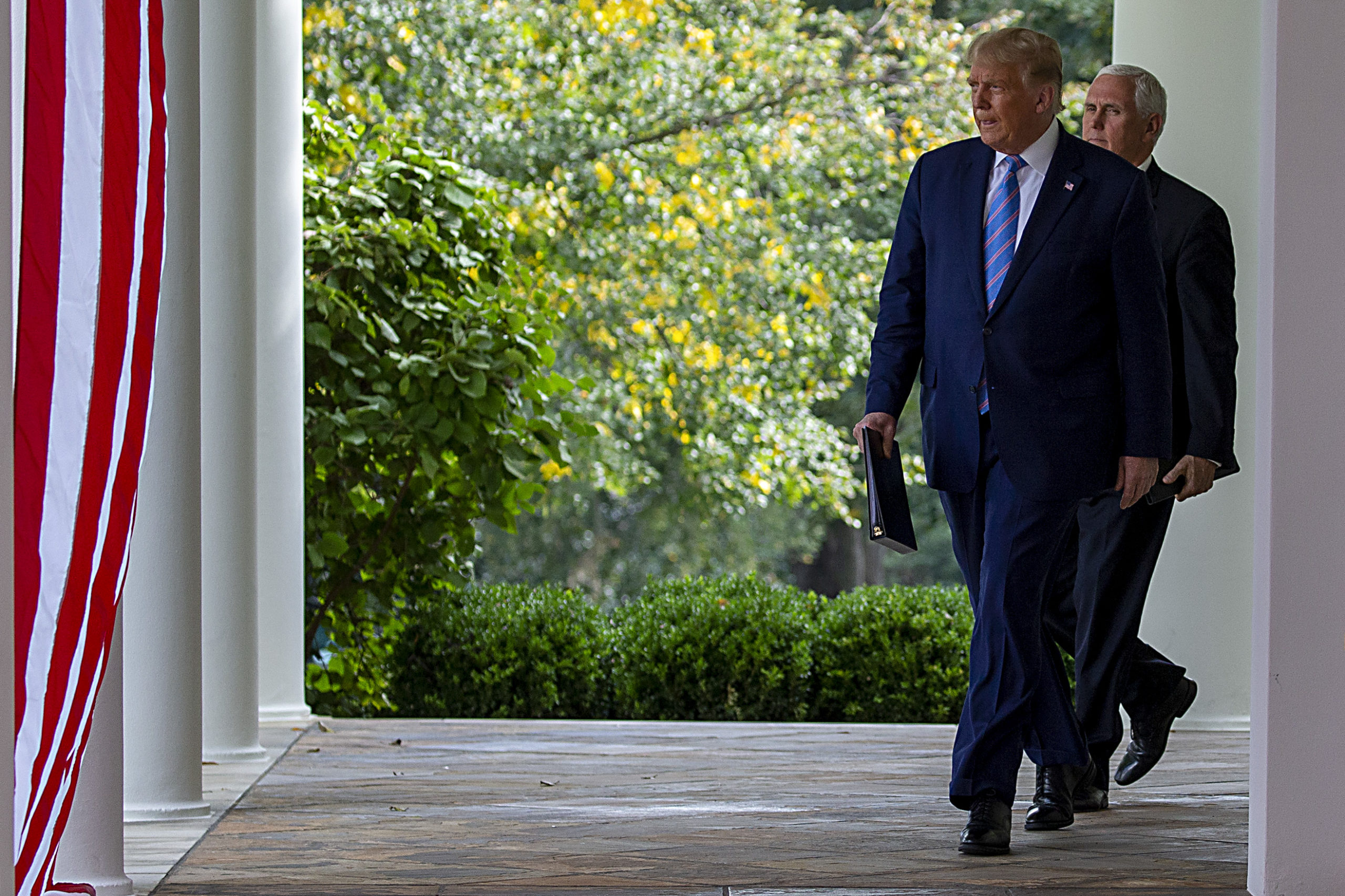 WASHINGTON, DC - SEPTEMBER 28: U.S. President Donald Trump followed by VIce President Mike Pence walk up to deliver an update on the nations coronavirus testing strategy in the Rose Garden of the White House on September 28, 2020 in Washington, DC.As the totals in the US reaches more than 7.1 million confirmed cases and 204,000 deaths, globally, there has been more than 33.1 million cases and more than998,000million fatalities according to John Hopkins University data. (Photo by Tasos Katopodis/Getty Images)