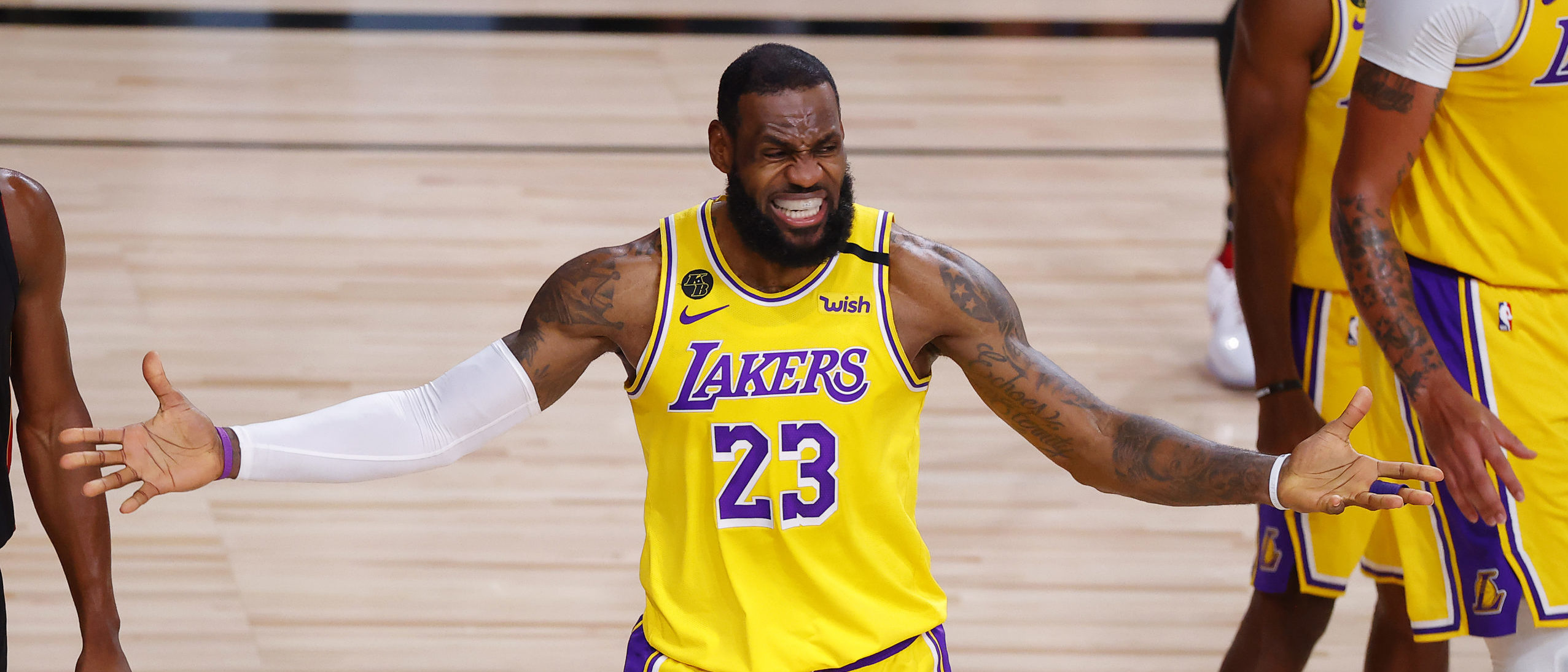 LAKE BUENA VISTA, FLORIDA - OCTOBER 06: LeBron James #23 of the Los Angeles Lakers reacts to a call that was then overturned during the third quarter against the Miami Heat in Game Four of the 2020 NBA Finals at AdventHealth Arena at the ESPN Wide World Of Sports Complex on October 6, 2020 in Lake Buena Vista, Florida. (Photo by Kevin C. Cox/Getty Images)