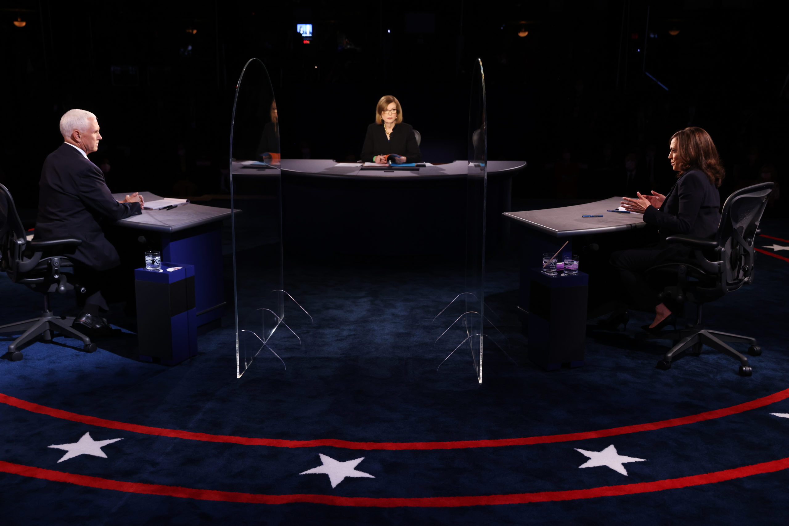 SALT LAKE CITY, UTAH - OCTOBER 07: Democratic vice presidential nominee Sen. Kamala Harris (D-CA) and U.S. Vice President Mike Pence participate in the vice presidential debate moderated by Washington Bureau Chief for USA Today Susan Page (C) at the University of Utah on October 7, 2020 in Salt Lake City, Utah. The vice presidential candidates only meet once to debate before the general election on November 3. (Photo by Justin Sullivan/Getty Images)