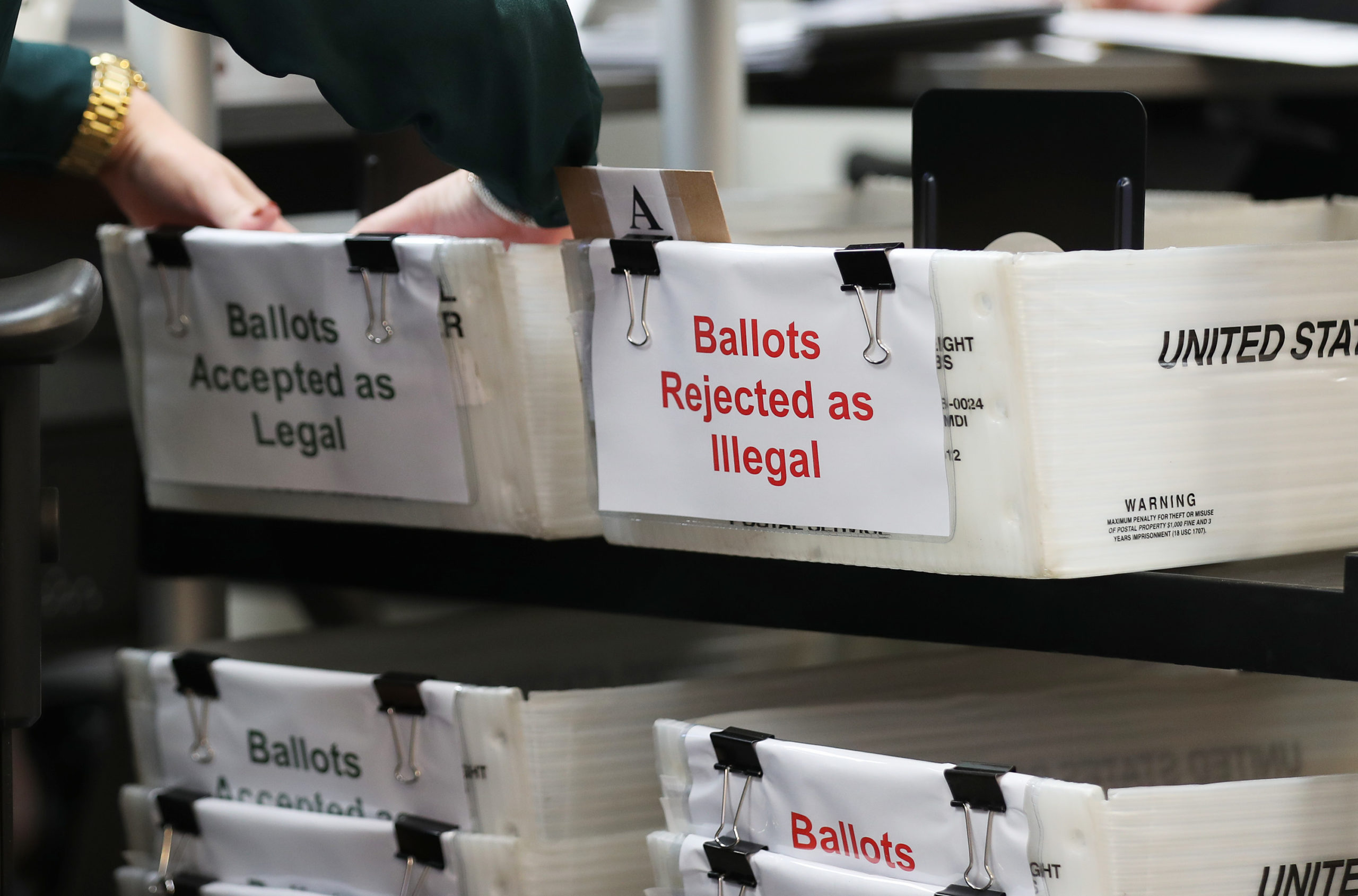Boxes for Vote-by-Mail ballots that have been rejected or accepted due to signature discrepancies are seen on Oct. 15 in Doral, Florida. (Joe Raedle/Getty Images)