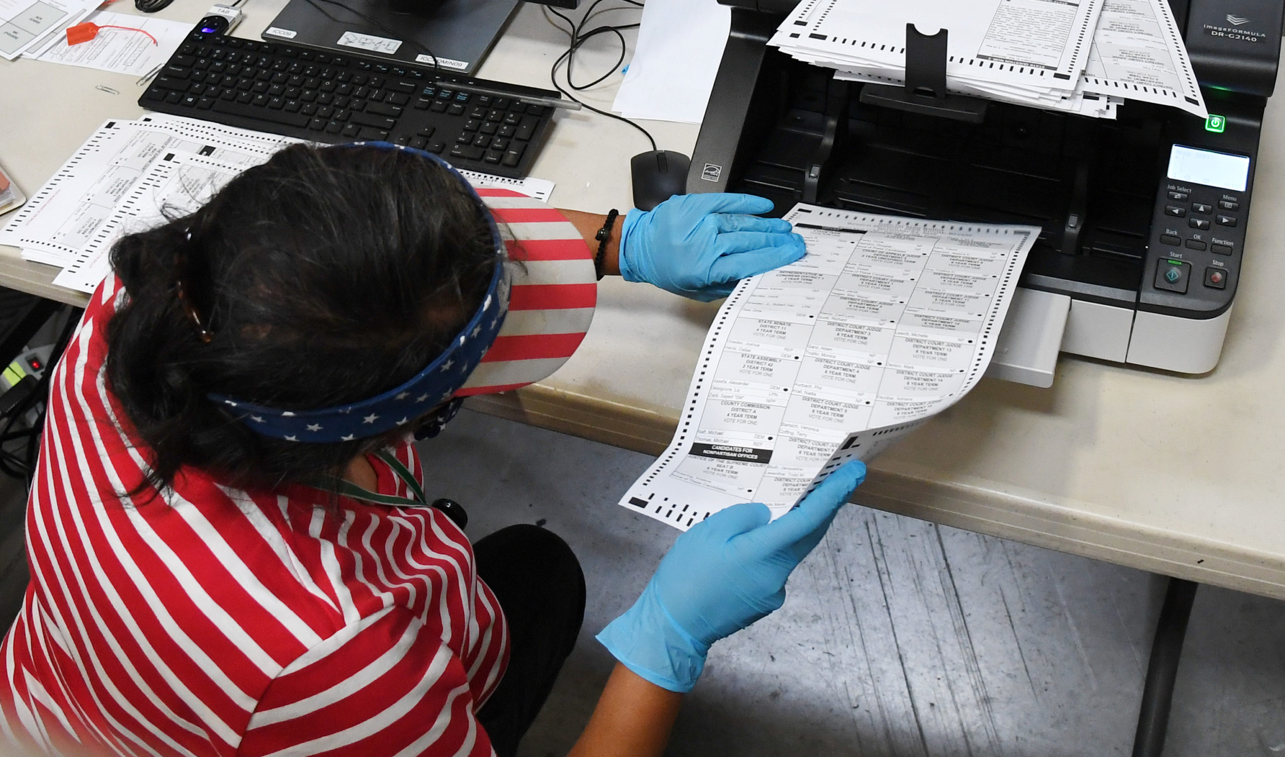 A Clark County election worker scans mail-in ballots at the Clark County Election Department on Oct. 20 in Las Vegas, Nevada. (Ethan Miller/Getty Images)