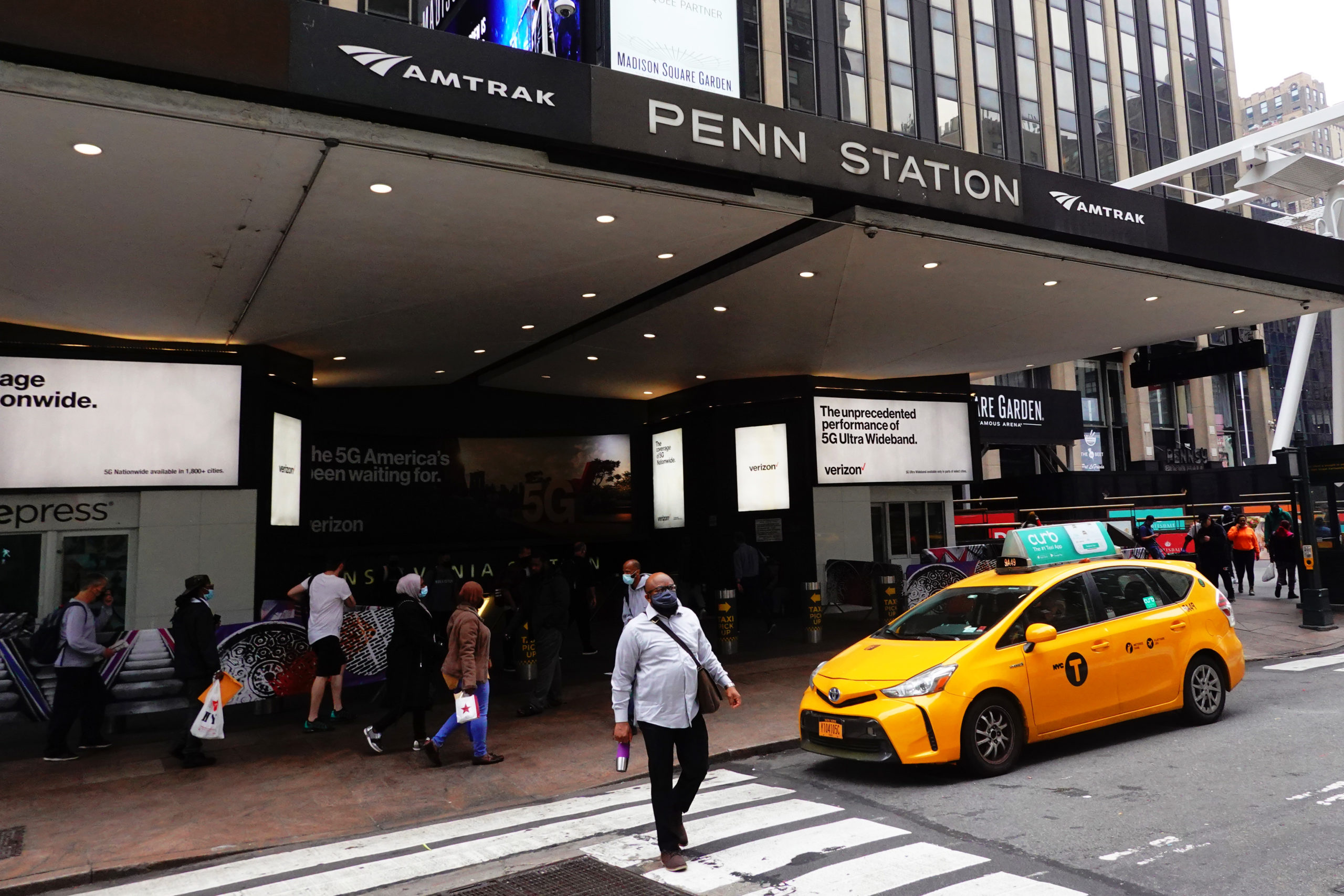 NEW YORK, NEW YORK - OCTOBER 22: People walk past the entrance of Penn Station on October 22, 2020 in New York City. Due to the coronavirus (COVID-19) pandemic, Amtrak ridership is down over 70% compared to 2019. (Michael M. Santiago/Getty Images)