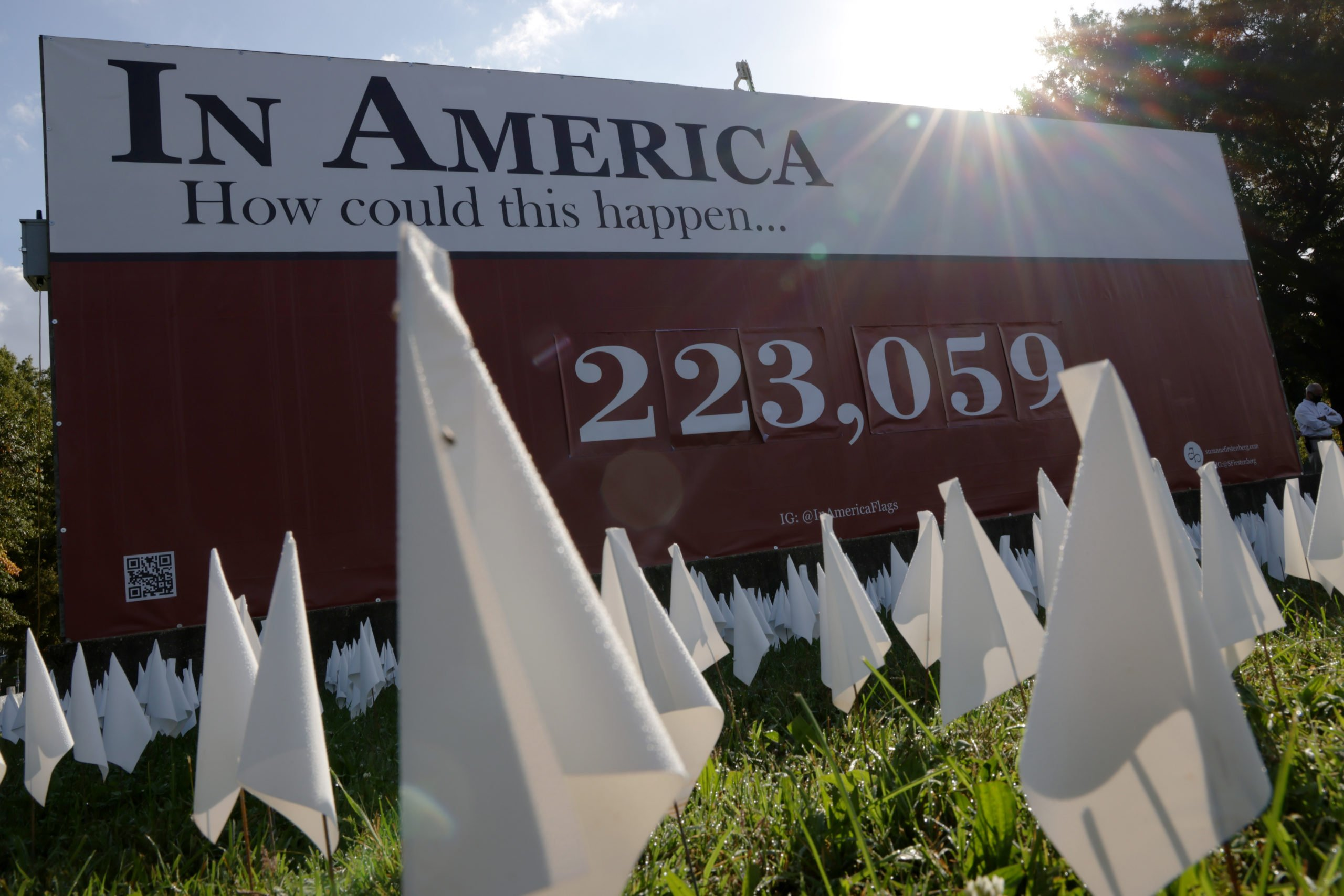 White flags are seen during a press preview of a public art project on Friday in Washington, DC depicting the amount of Americans who have died from coronavirus. (Photo by Alex Wong/Getty Images)