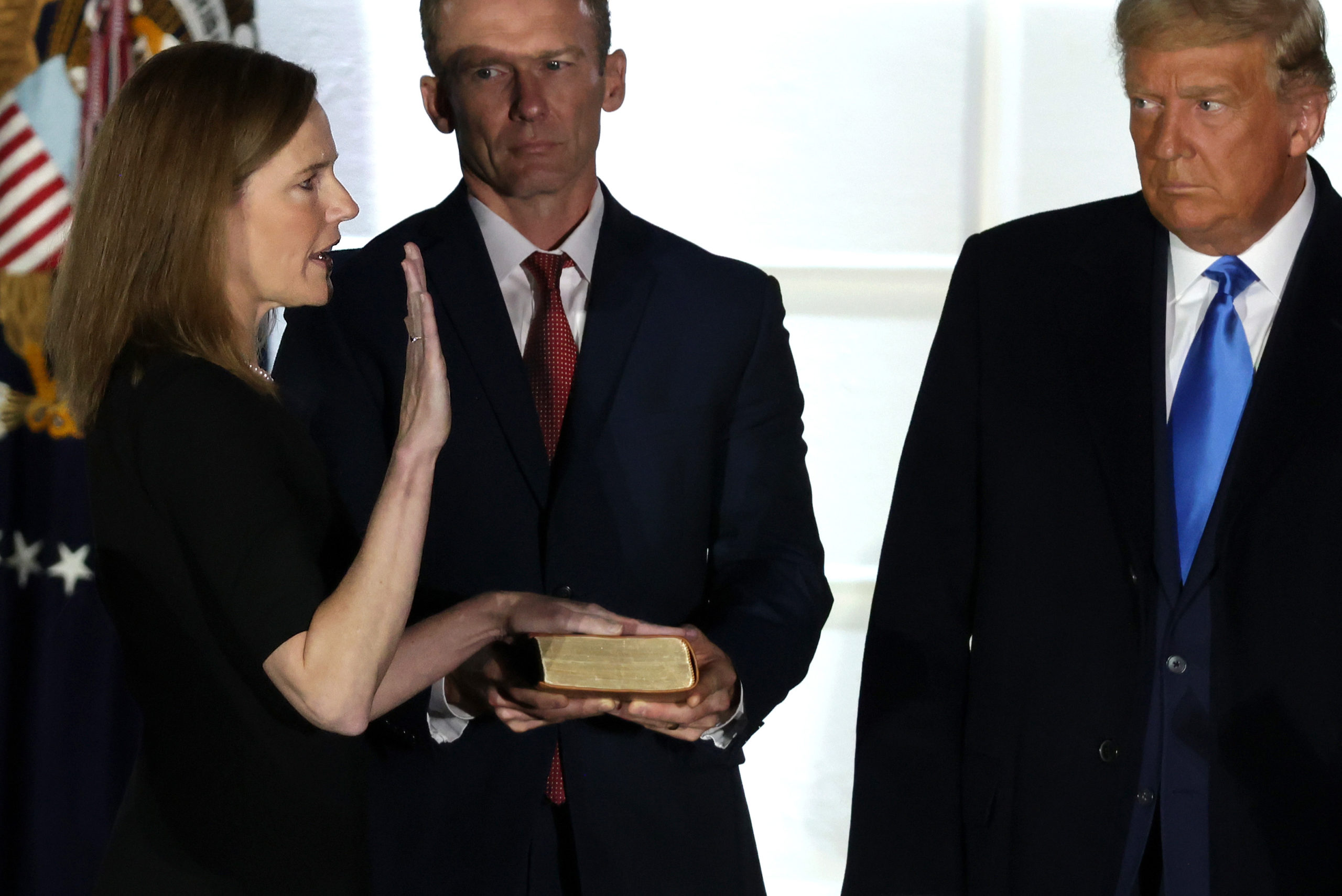 U.S. Supreme Court Associate Justice Amy Coney Barrett participates in a ceremonial swearing-in event as her husband Jesse Barrett and U.S. President Donald Trump look on on the South Lawn of the White House October 26, 2020 in Washington, DC. The Senate confirmed Barrett's nomination to the Supreme Court Monday by a vote of 52-48. (Alex Wong/Getty Images)
