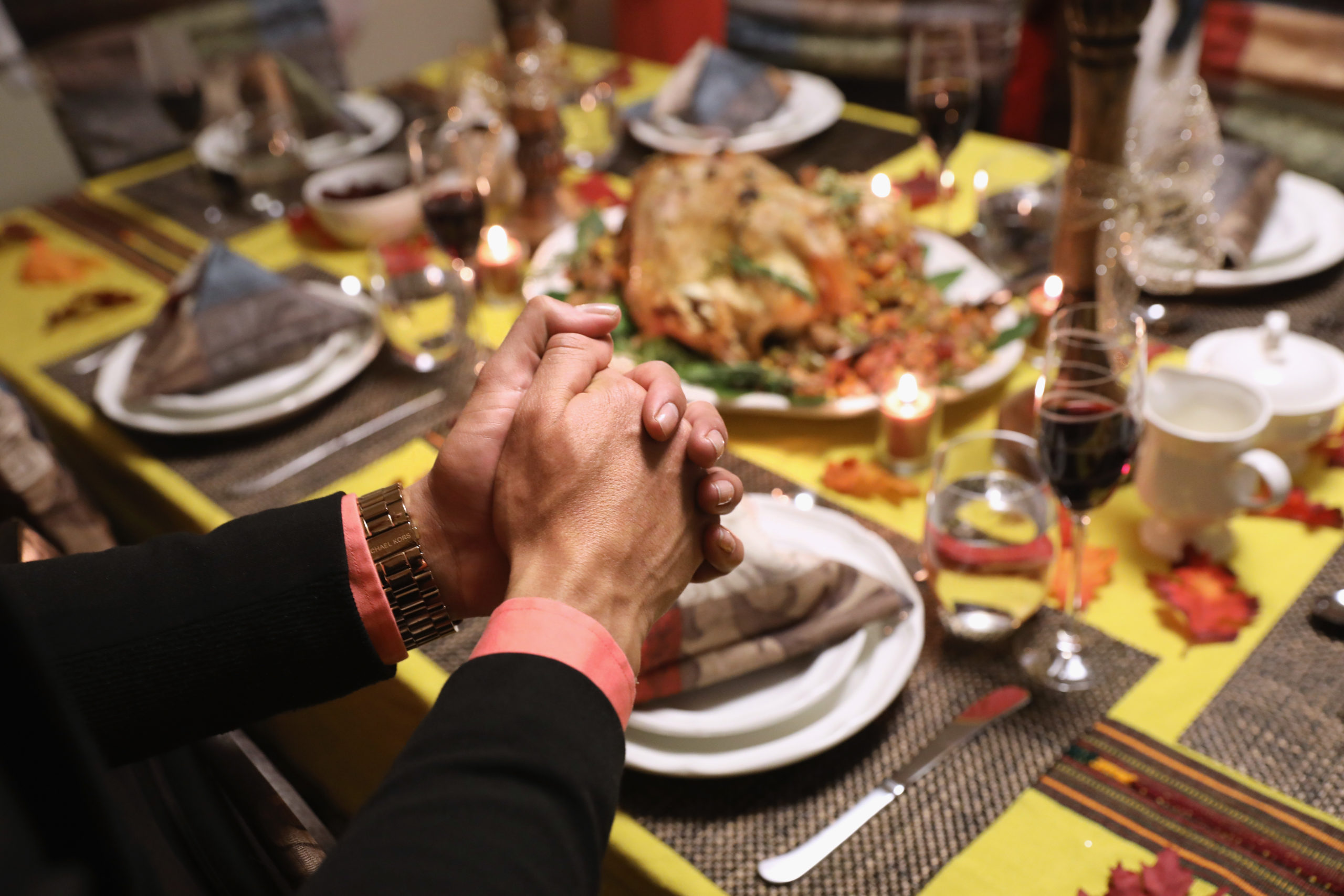 STAMFORD, CT - NOVEMBER 24: Central American immigrants and their families pray before Thanksgiving dinner on November 24, 2016 in Stamford, Connecticut. Family and friends, some of them U.S. citizens, others on work visas and some undocumented immigrants came together in an apartment to celebrate the American holiday with turkey and Latin American dishes. They expressed concern with the results of the U.S. Presidential election of president-elect Donald Trump, some saying their U.S.-born children fear the possibilty their parents will be deported after Trump's inauguration. (Photo by John Moore/Getty Images)