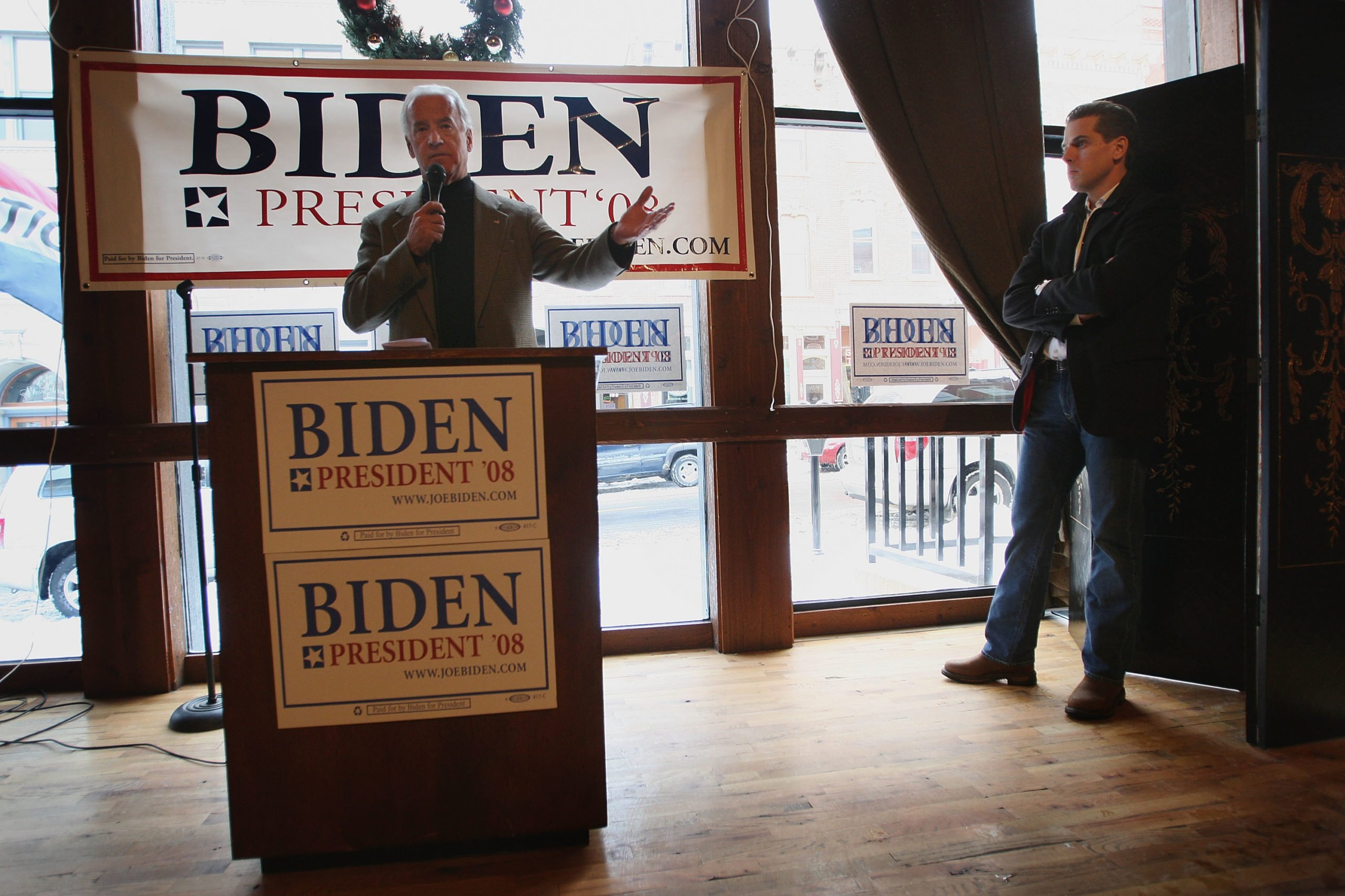 Joe Biden fields questions as his son Hunter Biden looks on at a campaign stop on Dec. 9 in Iowa. (Scott Olson/Getty Images)