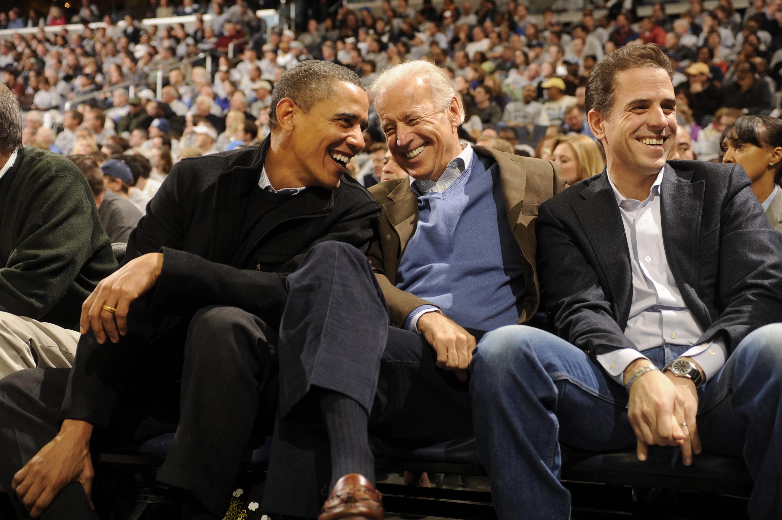 Former President Barack Obama, Joe Biden and Hunter Biden attend a 2010 basketball game. (Mitchell Layton/Getty Images)